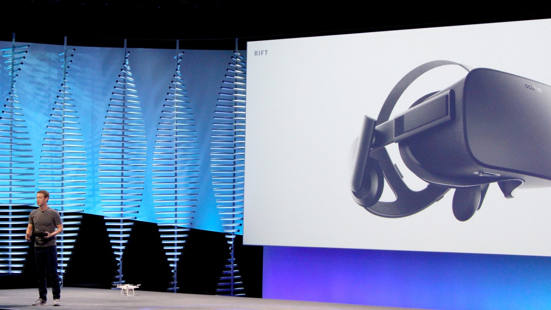 Facebook chief Mark Zuckerberg uses a small drone and an Oculus Rift VR headset during a keynote at the social network's headquarters in San Francisco in April 2016.