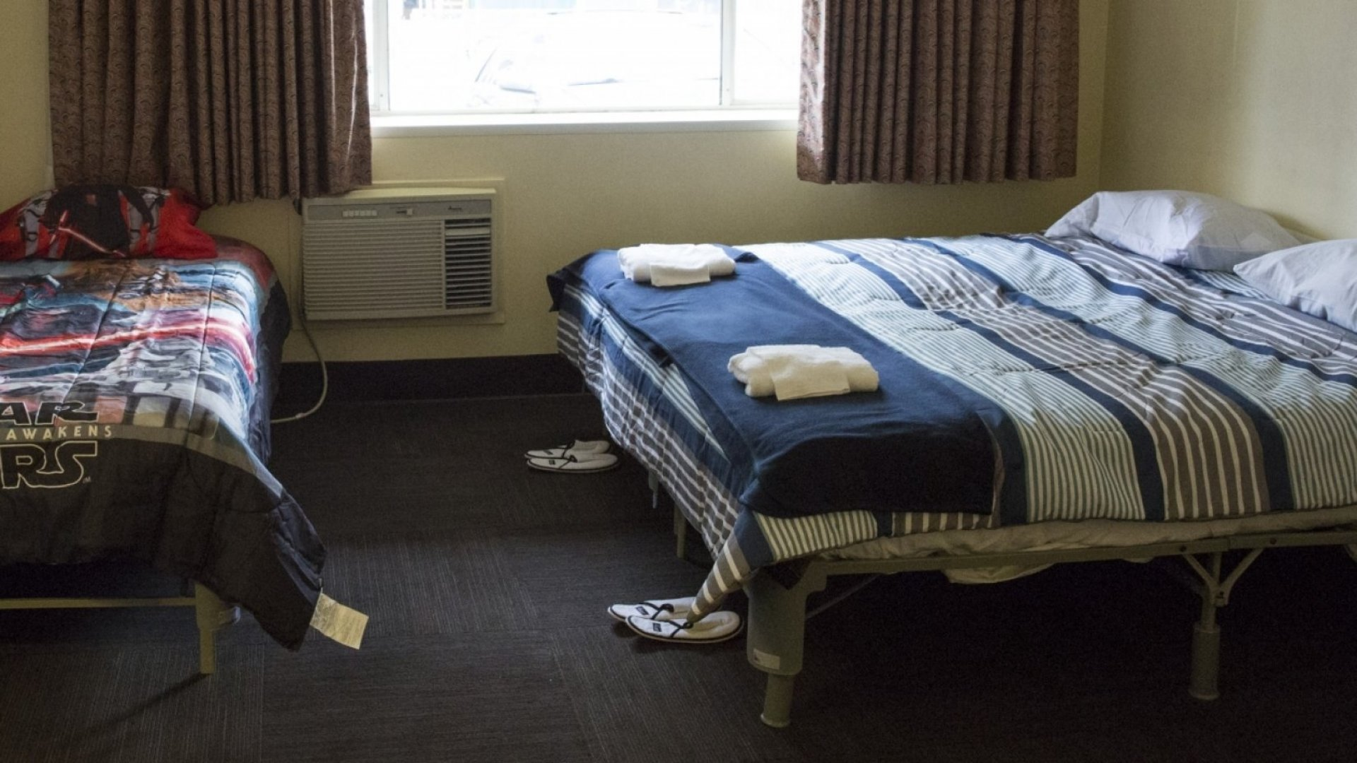 A bedroom is pictured inside a former motel building owned by Amazon that the company has offered to the non profit Mary's Place to use as a temporary shelter for homeless women and their families in Seattle, Washington.