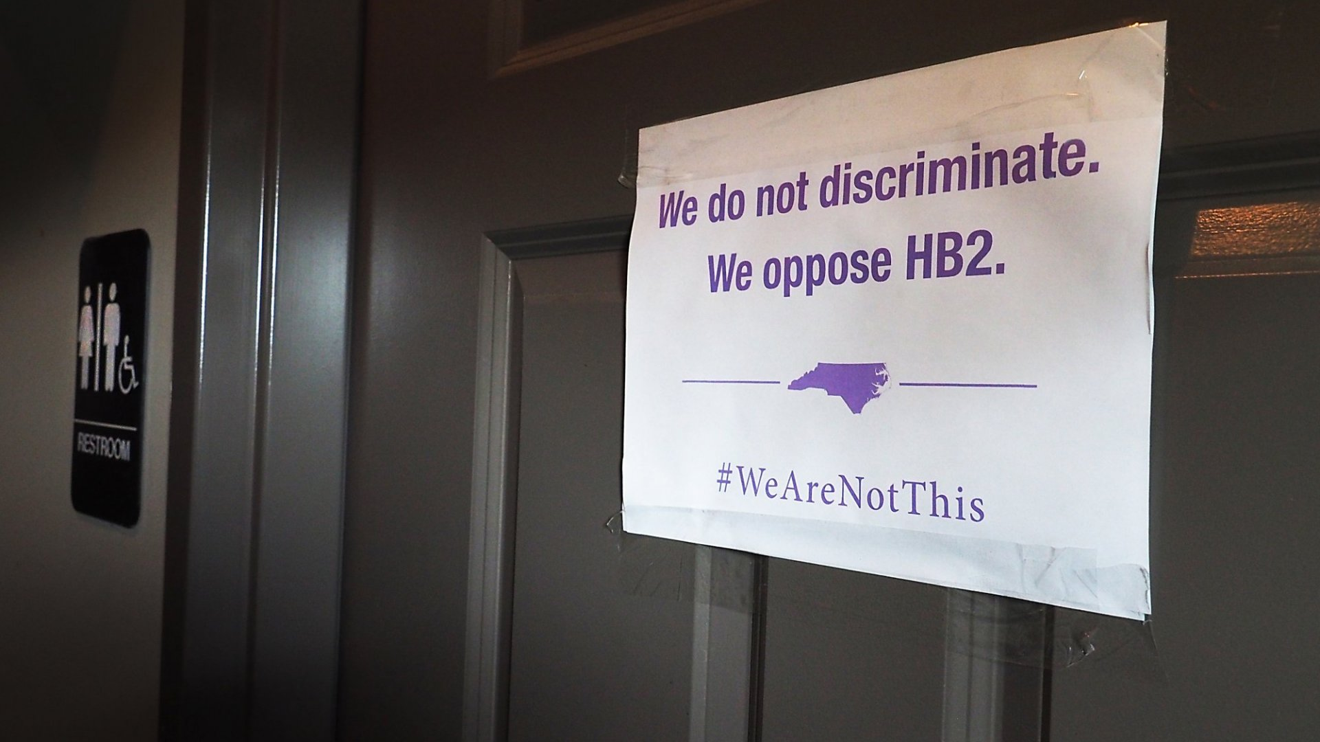 A sign on a bathroom in a Durham, NC bar.