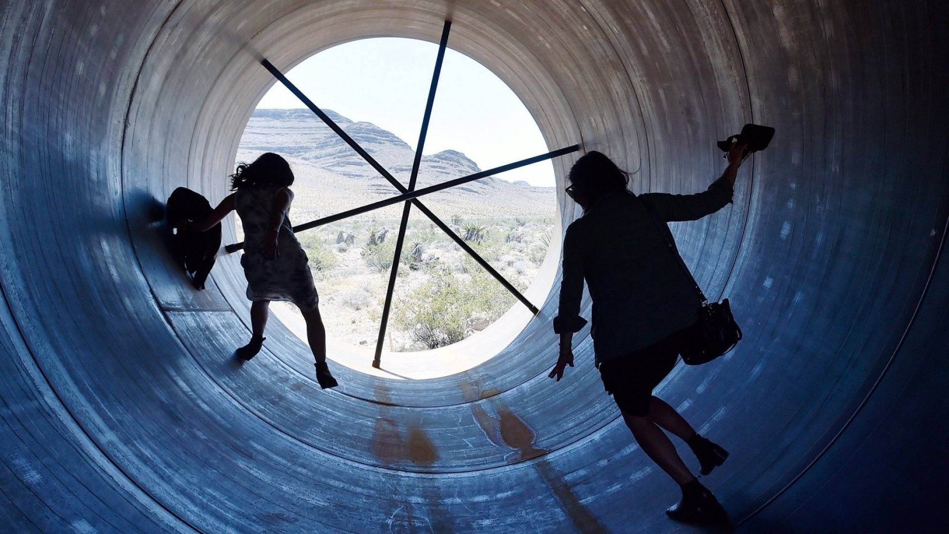 People walk through a Hyperloop tube after the first test of a propulsion system at the Hyperloop One Test and Safety site on May 11, 2016 in North Las Vegas, Nevada.