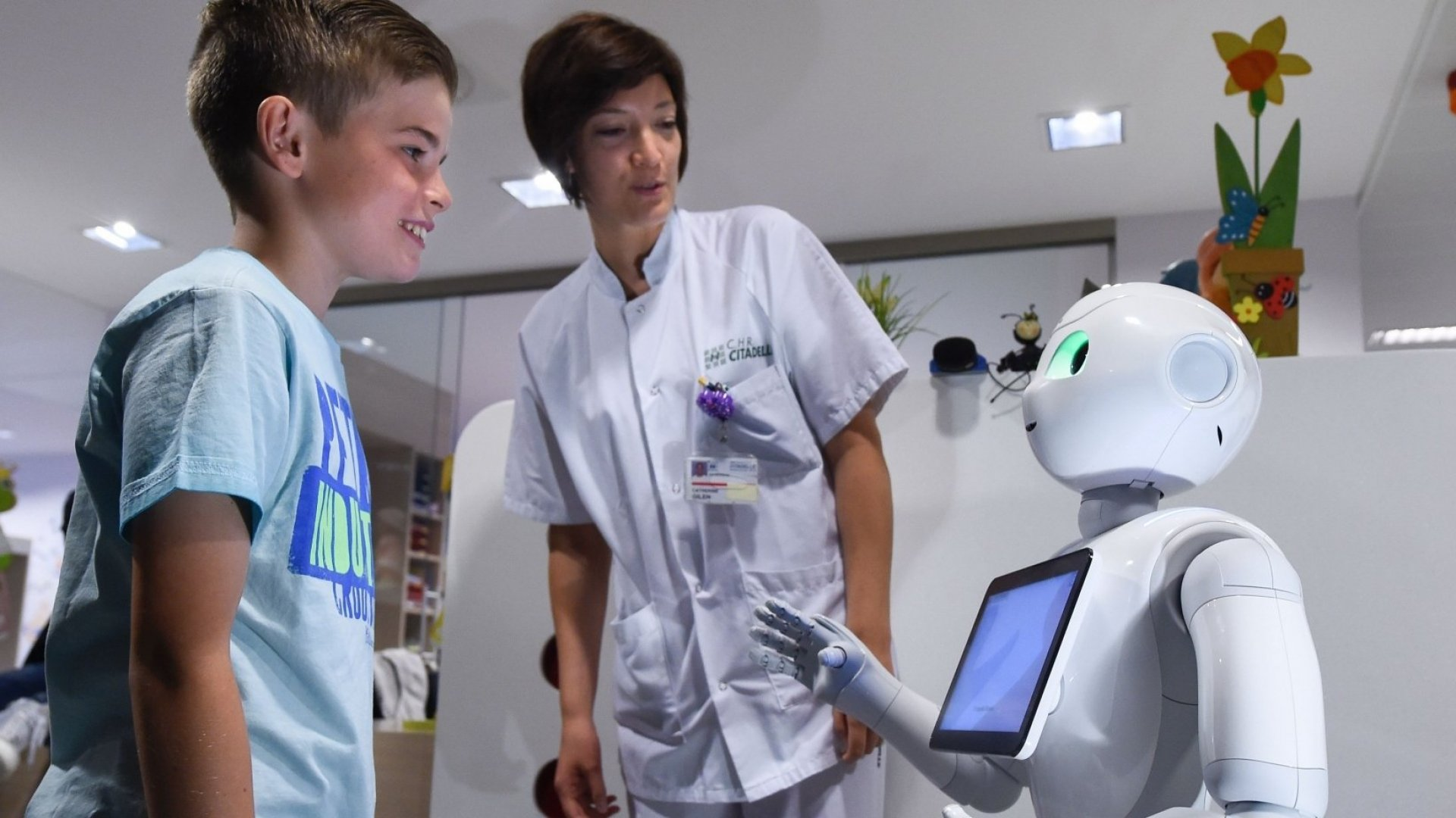 Pepper, a robot made by SoftBank Robotics, works alongside doctors and nurses at a hospital in Belgium.