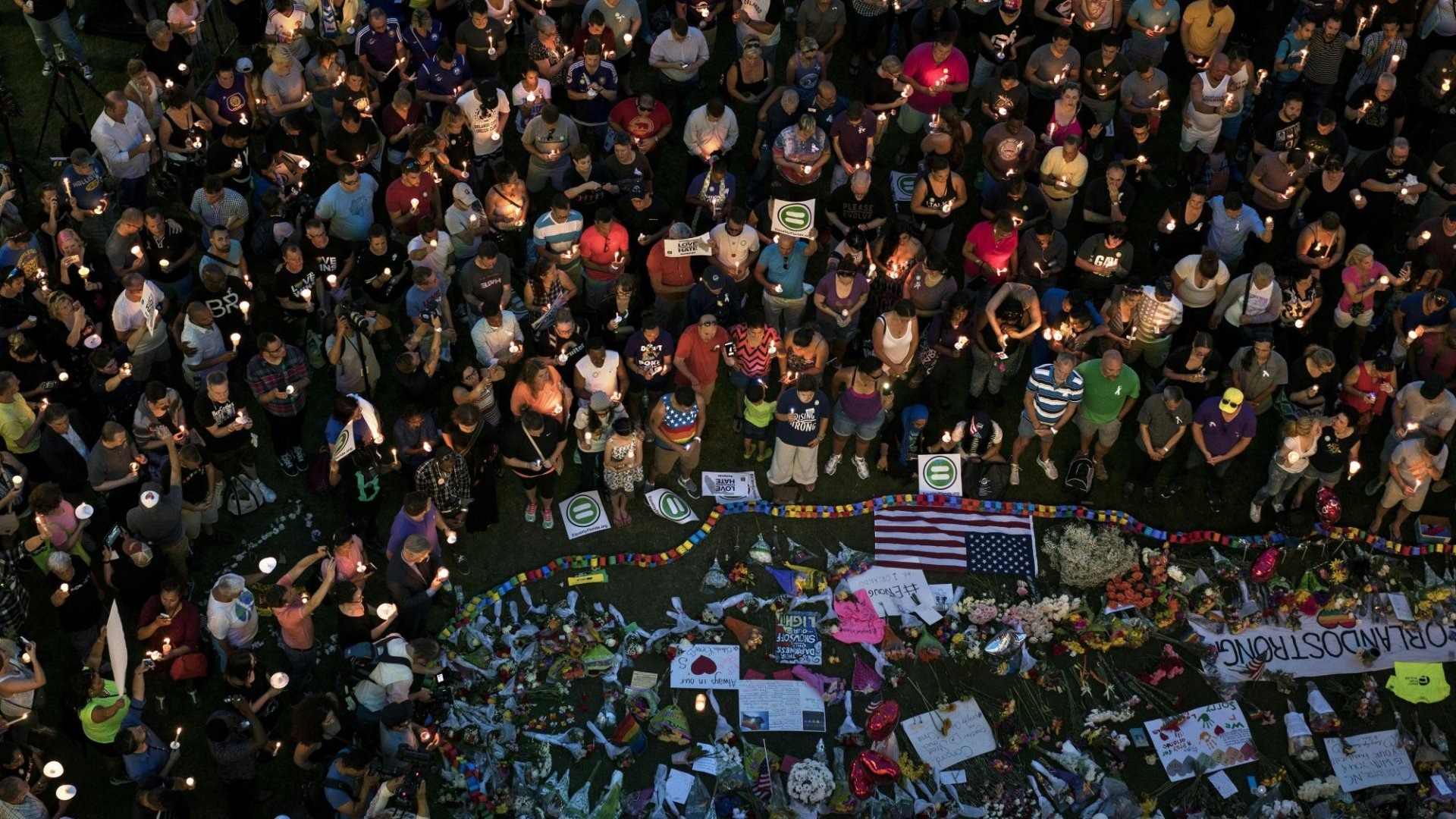 Mourners come out for a vigil at the Dr. Phillips Center for the Performing Arts in Orlando to pay respects to the 49 people who were killed over the weekend at Pulse, an LGBT-friendly bar in Orlando.