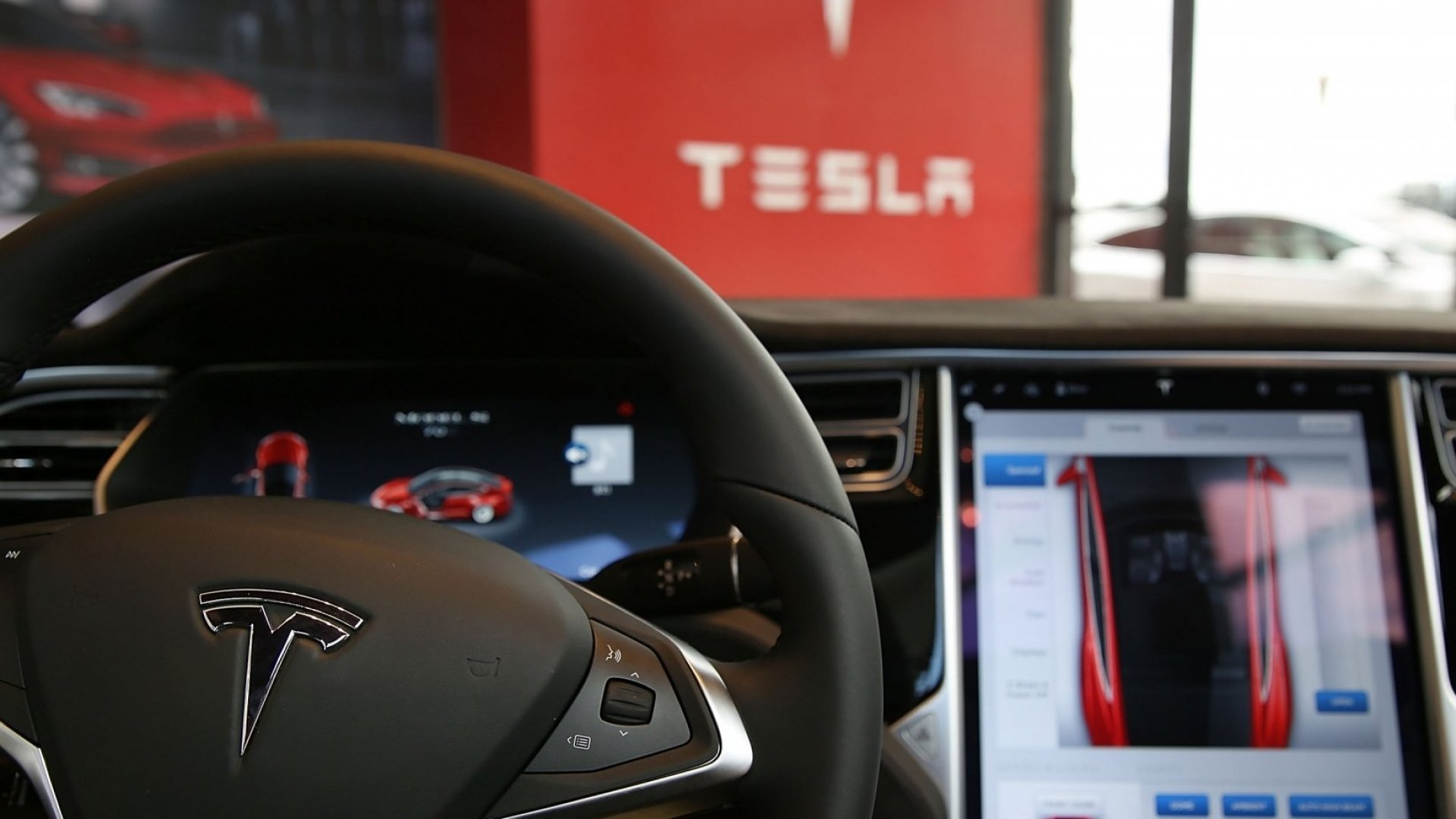 Behind the wheel of a Tesla. Could hackers seize control?