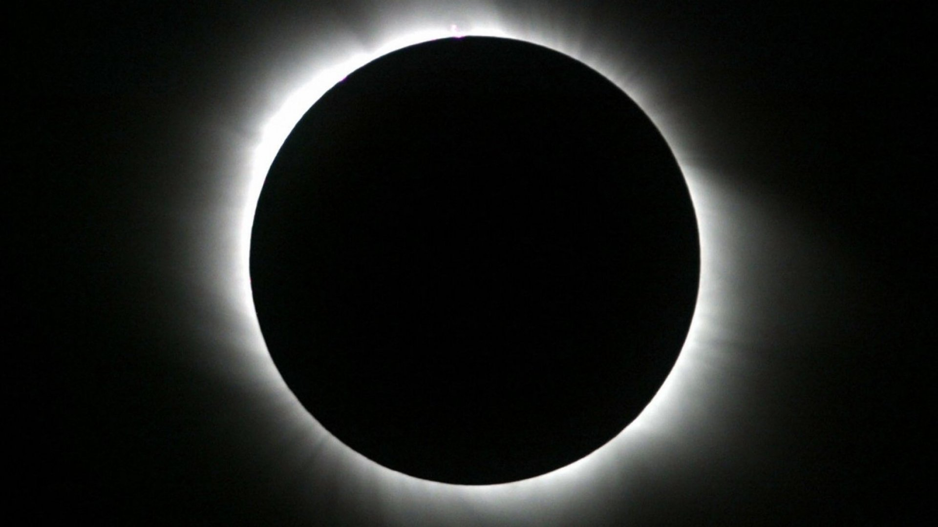 A total solar eclipse occurs when the moon comes between the Earth and the sun, completely obscuring the solar disk for a few minutes.