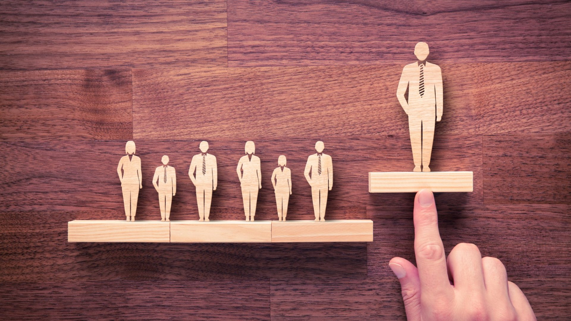 The Secrets to Breaking Down Barriers and Helping Midlevel Managers Succeed