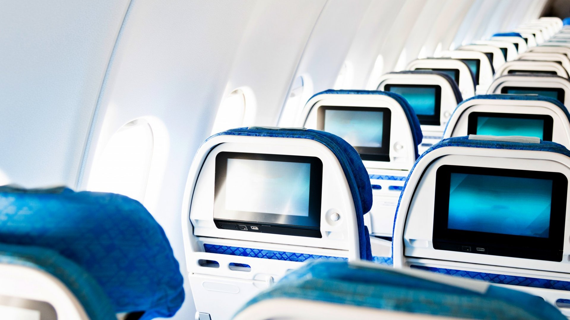 Pack This Simple Item in Your Carry-On to Prevent the Airlines From Spying on You in Your Seat