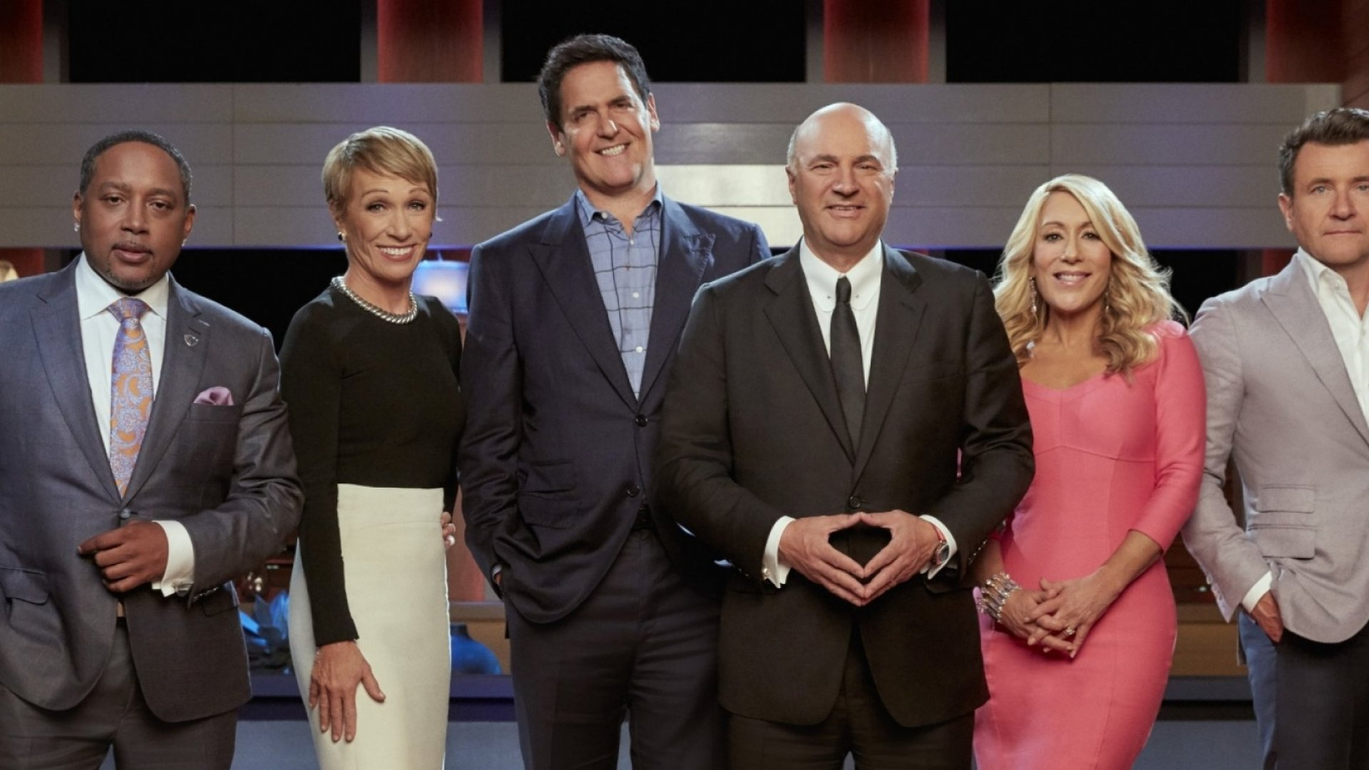 "Daymond John (left), Barbara Corcoran, Mark Cuban, Kevin O'Leary, Lori Greiner, and Robert Herjavec are the ""Sharks"" on ABC's <em>Shark Tank.</em>"