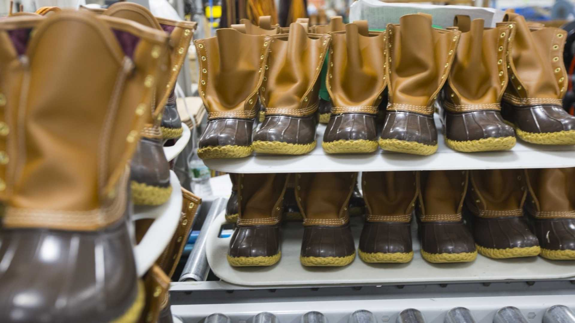 Bean boots sit on a conveyor belt at the LL Bean factory in Brunswick, ME.