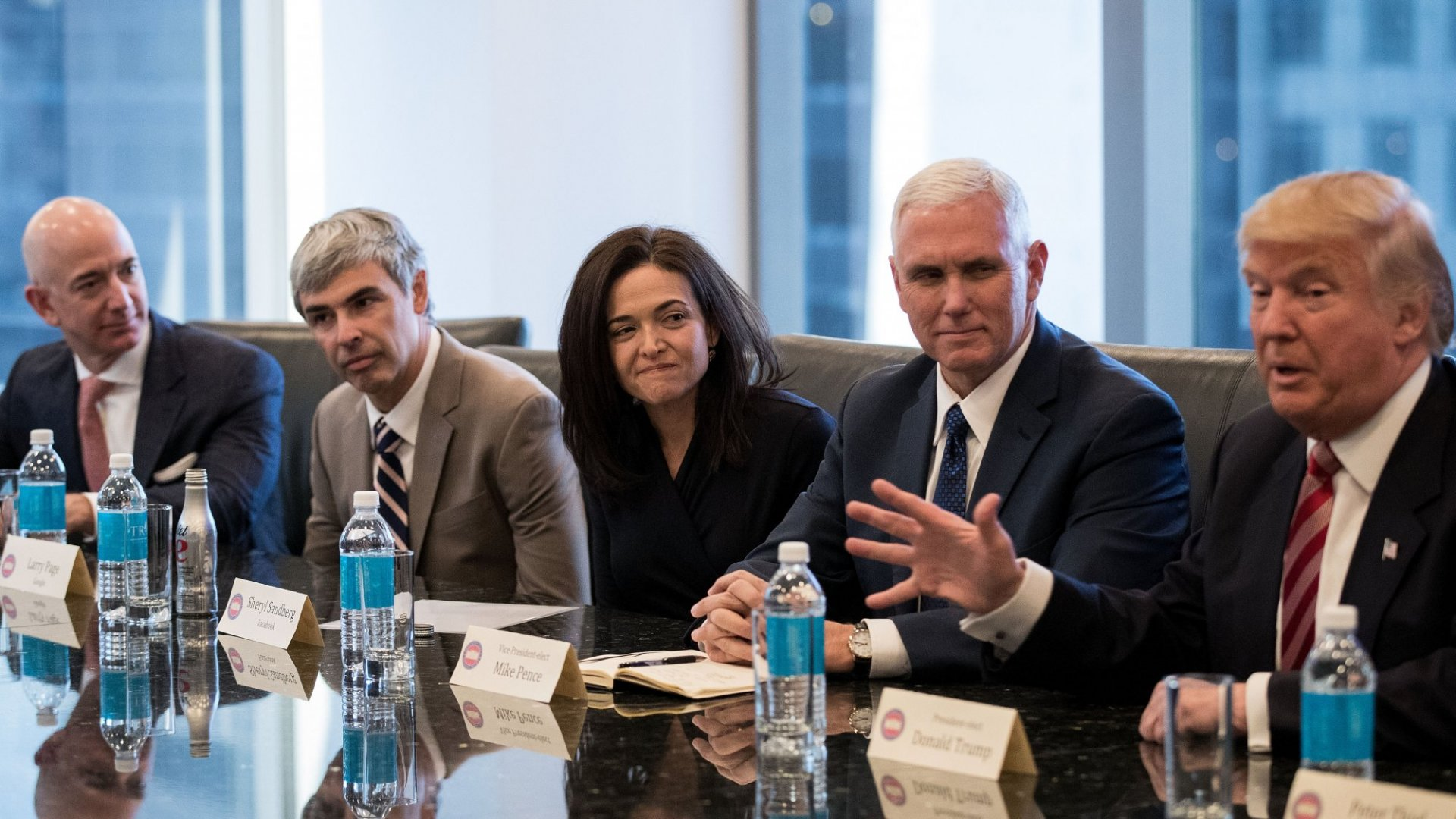 (L to R) Jeff Bezos, chief executive officer of Amazon; Larry Page, chief executive officer of Alphabet (parent company of Google); Sheryl Sandberg, chief operating officer of Facebook; and Vice President-elect Mike Pence listen as President-elect Donald Trump speaks during a meeting of technology executives at Trump Tower, December 14, 2016 in New York City.
