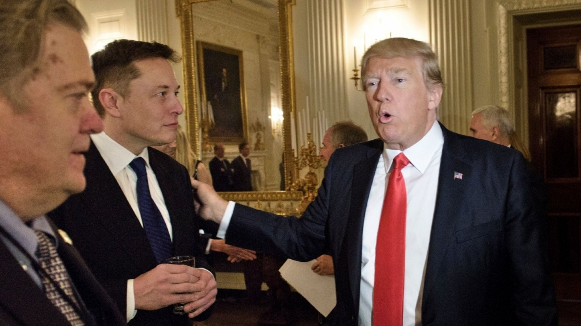 President Trump greets Elon Musk, SpaceX and Tesla CEO, before a White House policy and strategy forum with executives on February 3.