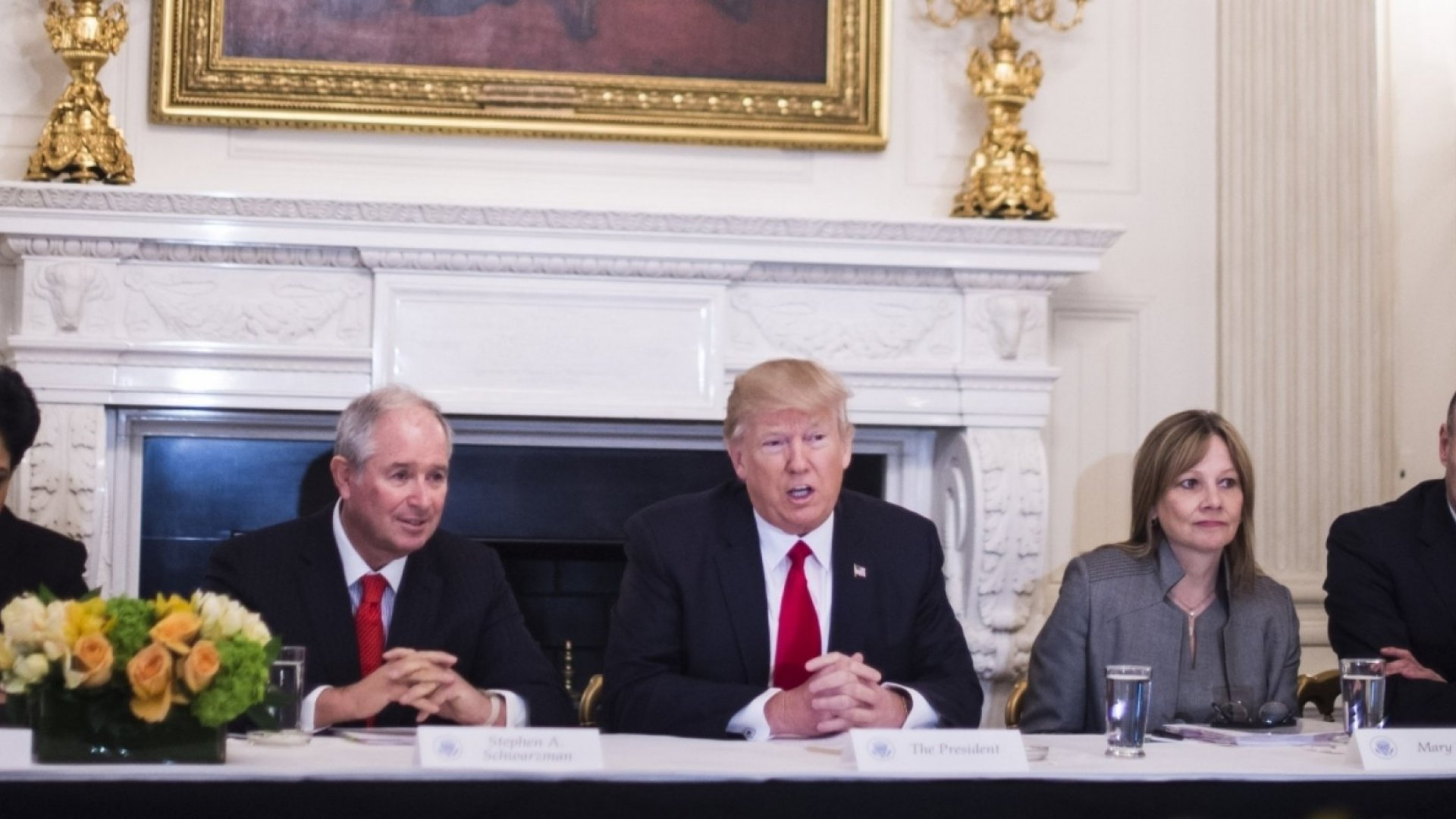 President Donald Trump speaks to business leaders during a strategy and policy forum in the State Dining Room.