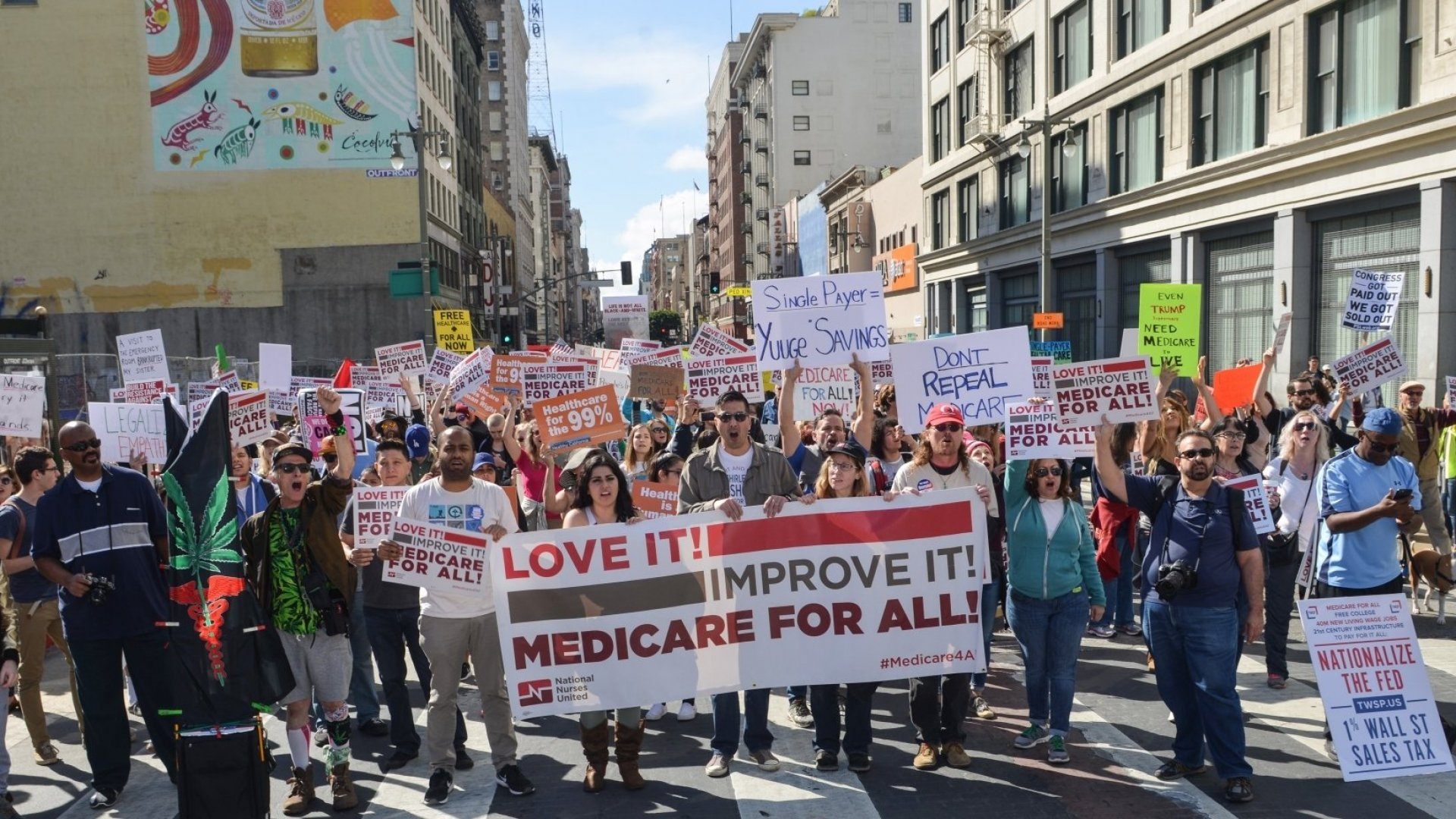 Demonstrators march and rally to protest against President Donald Trump's and the GOP's race to repeal and replace the Affordable Care Act (aka Obamacare) at Los Angeles, California, United States on February 4, 2017.