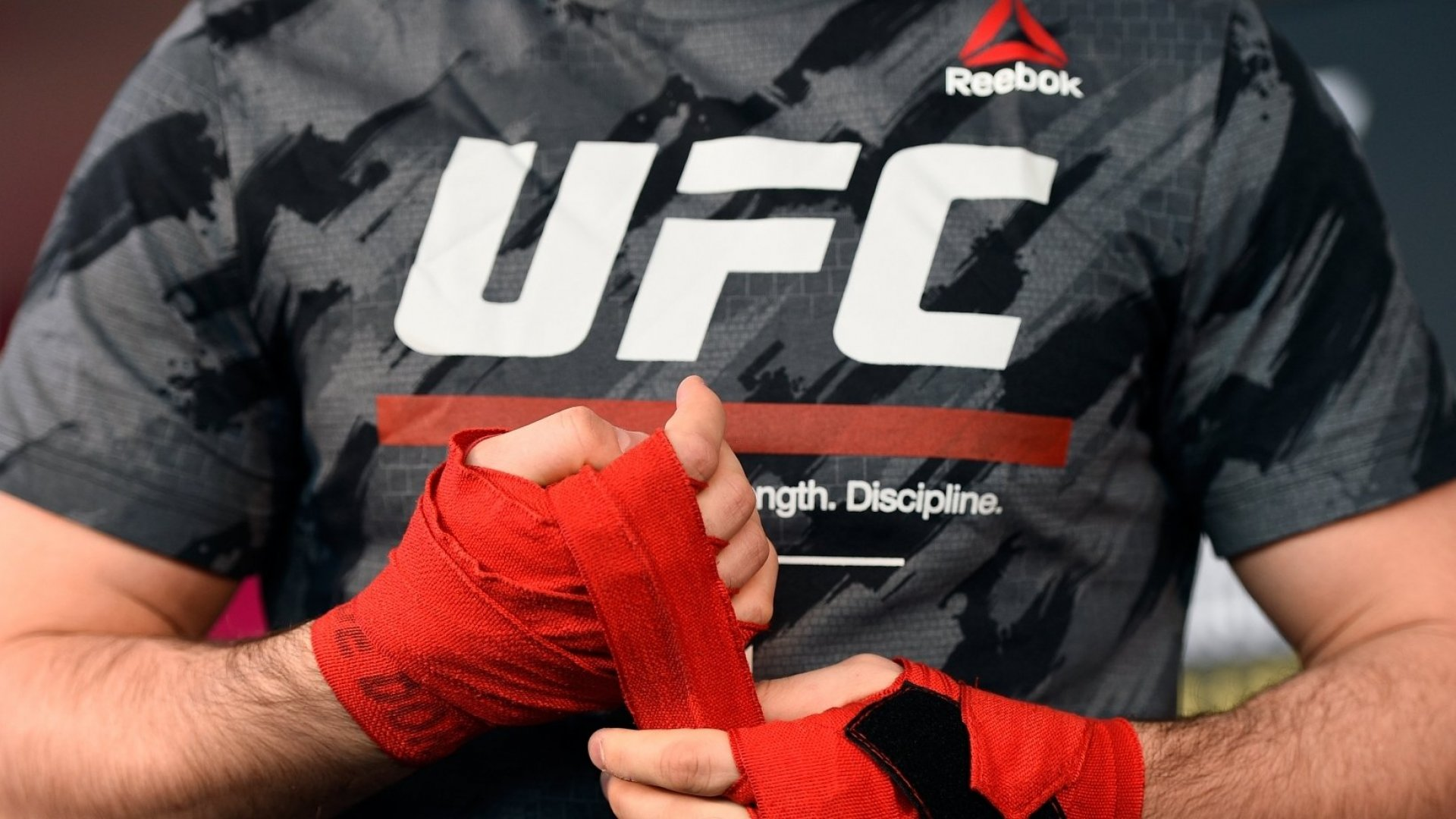 Reebok's shift to a focus on fitness includes sponsorship of the UFC.