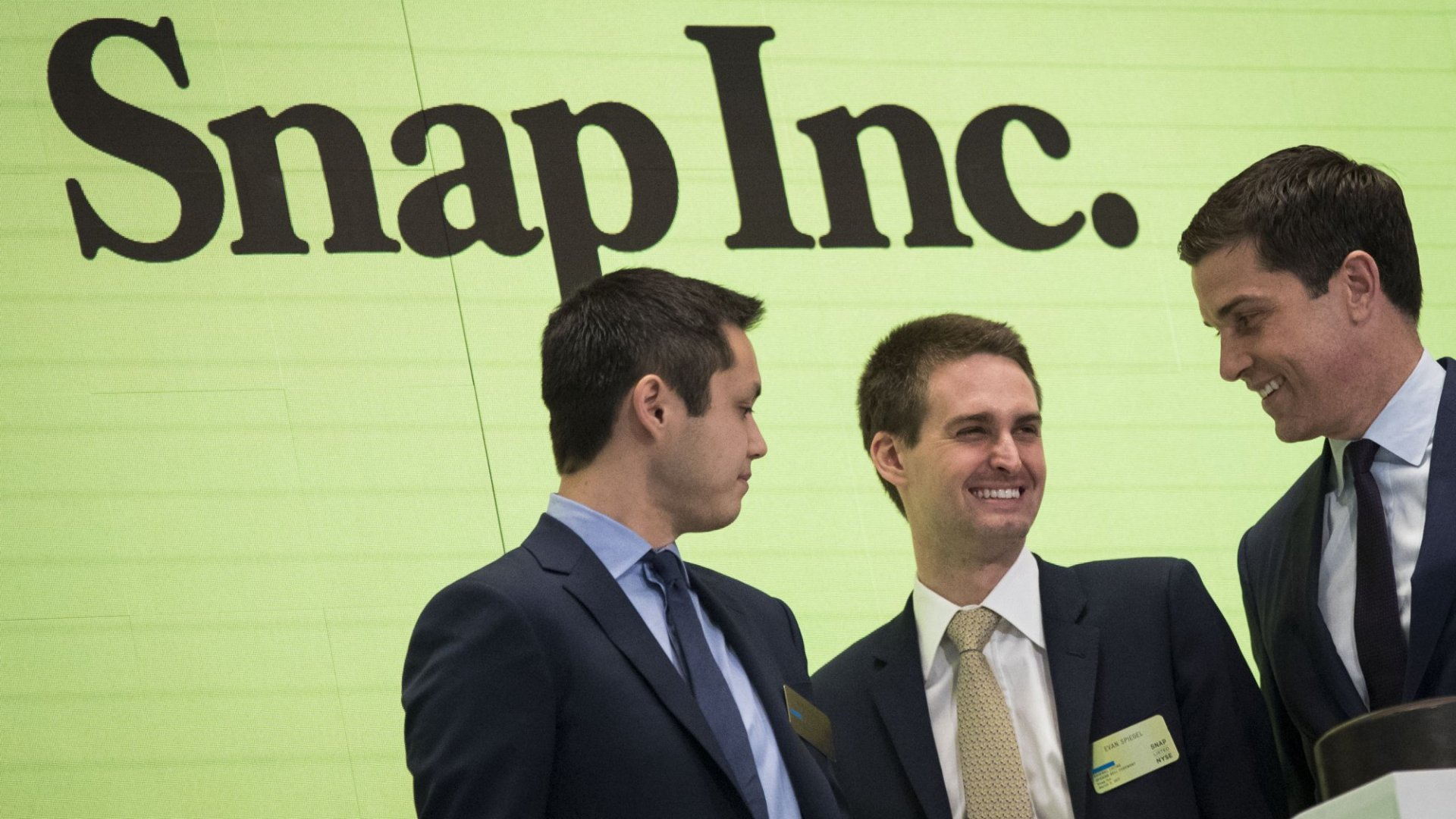 Snap CTO Bobby Murphy (left) and CEO Evan Spiegel (center) at the New York Stock Exchange.