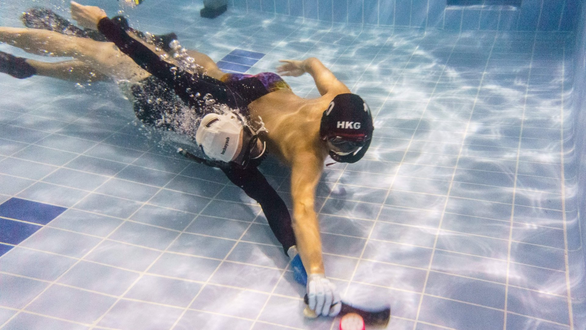 > Underwater Hockey Players
