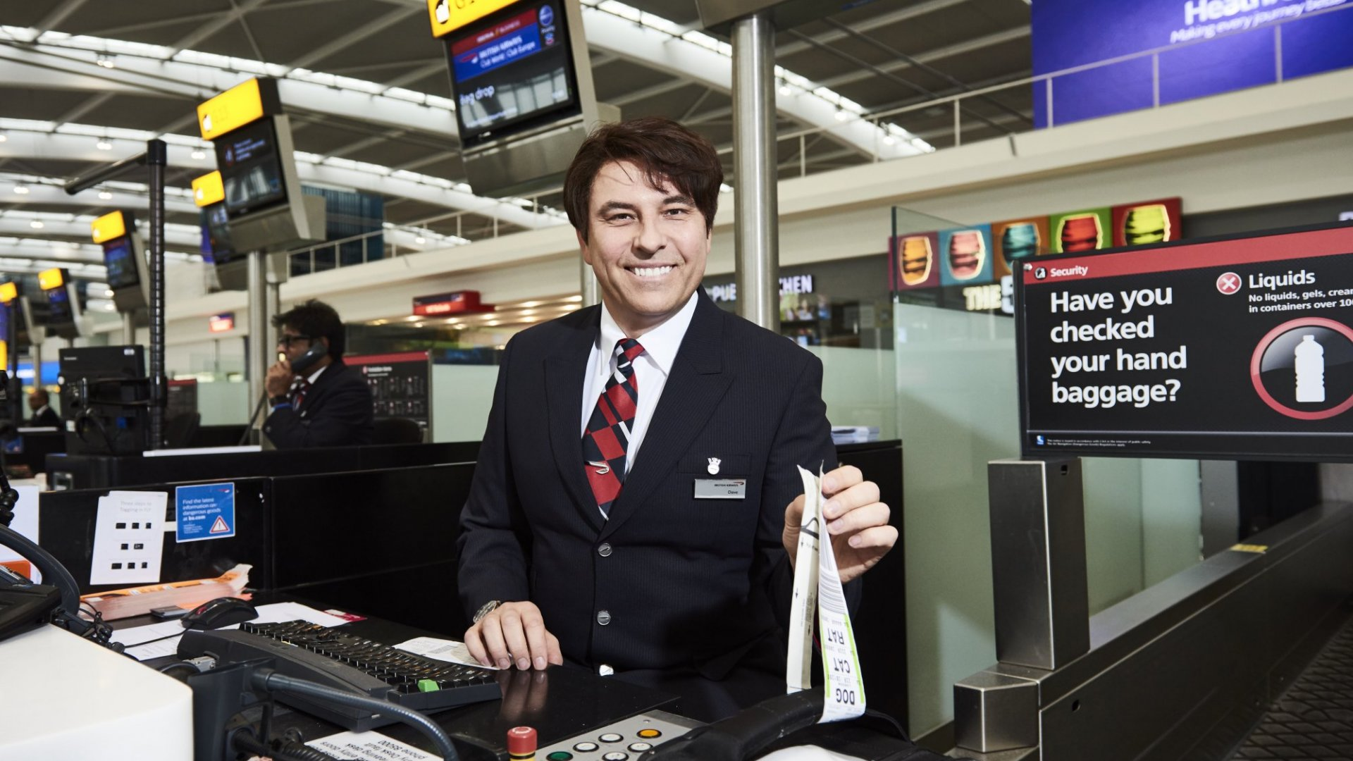 This is the comedian David Walliams, checking in British Airways passengers. I would rather him than a machine.