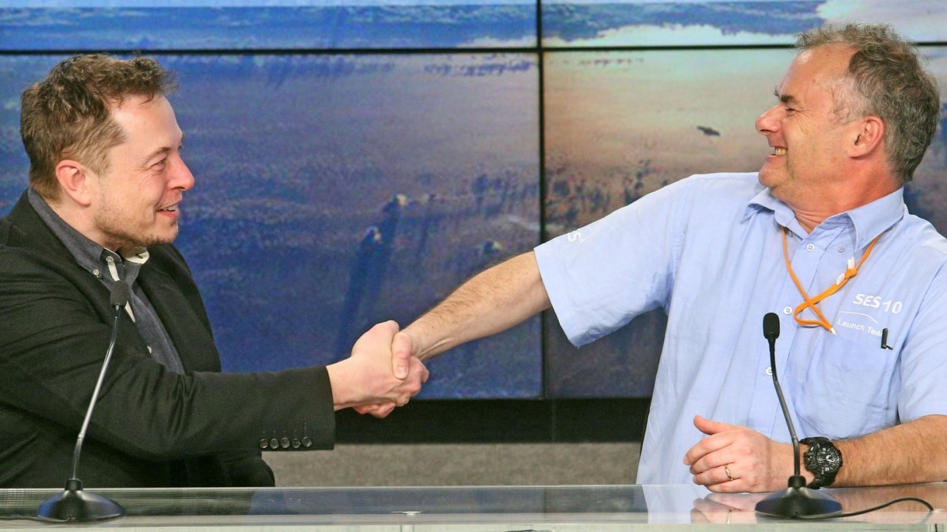 SpaceX CEO Elon Musk, left, shakes the hand of CTO Martin Halliwell, SES Satellites, after a SpaceX Falcon 9 rocket, powered by a previously flown first-stage rocket, blasted off from Kennedy Space Center on Thursday, March 30, 2017. This is the first time SpaceX has reused a booster rocket for a space mission.