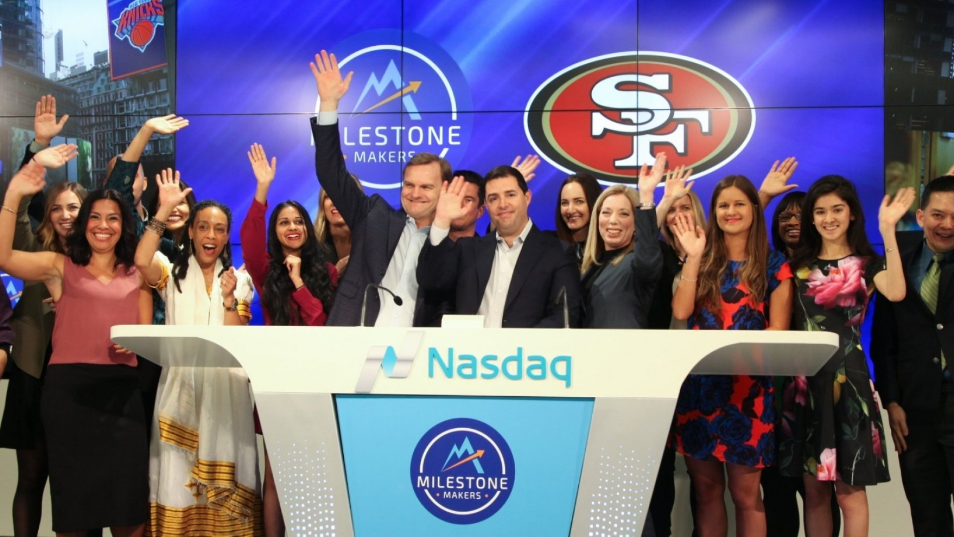 CEO of the San Francisco 49ers Jed York (center) rings the Nasdaq closing bell with Bruce Aust, Vice Chairman of Nasdaq (center L), Nicola Corzine, Executive Director at the Nasdaq Entrepreneurial Center (center R) and the second graduating class of entrepreneurs from the Center Milestone Makers program on April 11, 2017 inSan Francisco.