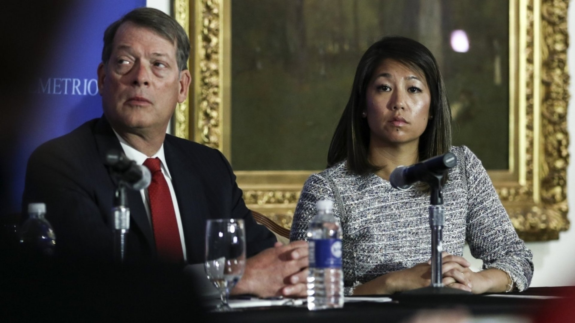 Crystal Dao Pepper (R), daughter of Dr. David Dao, pauses as she speaks about her father as she sits with her attorney Stephen Golan during a news conference on April 13, 2017