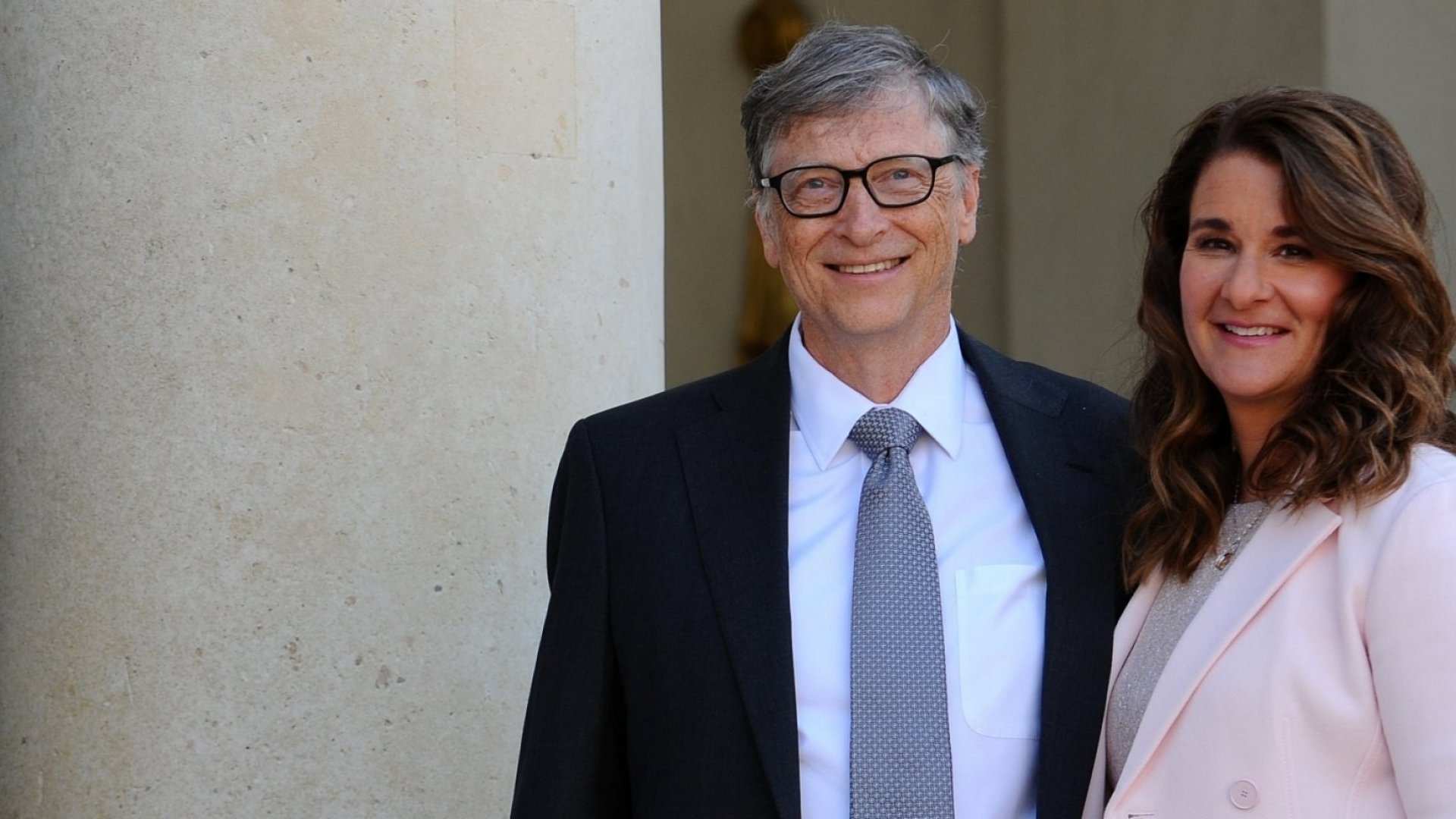 Bill and Melinda Gates pose in front of the Elysee Palace before receiving the award of Commander of the Legion of Honor by French President Francois Hollande on April 21, 2017 in Paris, France.