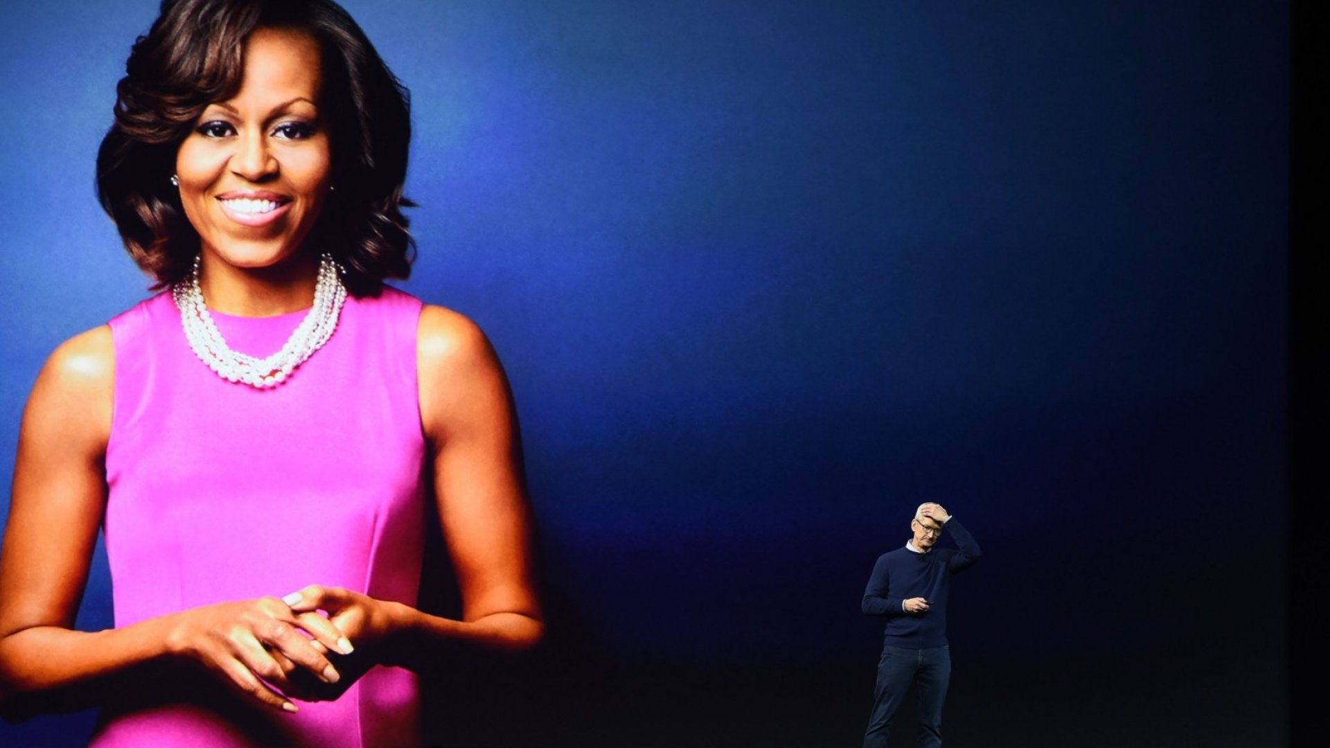 Apple CEO Tim Cook announcing Michelle Obama's surprise appearance at the Worldwide Developer Conference (WWDC)
