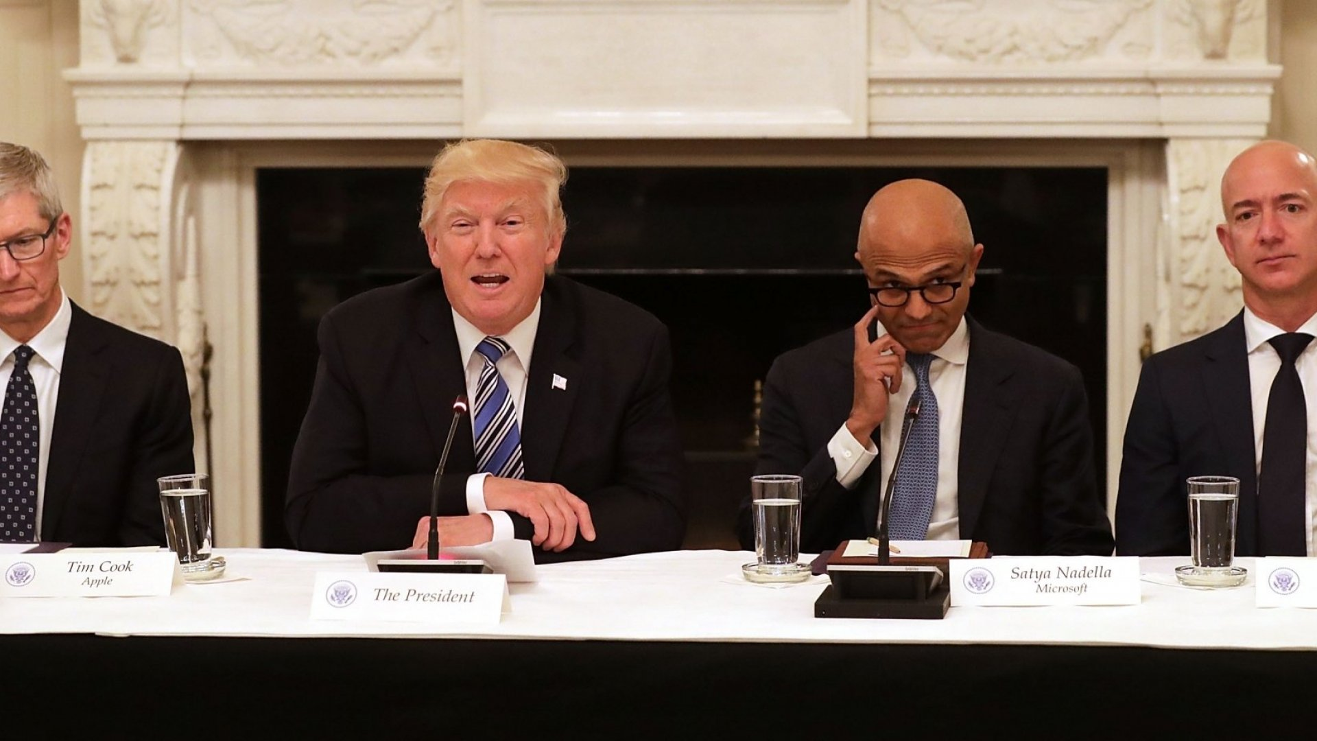 President Donald Trump welcomes members of his American Technology Council, including (L-R) Apple CEO Tim Cook, Microsoft CEO Satya Nadella and Amazon CEO Jeff Bezos in the State Dining Room of the White House June 19, 2017 in Washington, DC. According to the White House, the council's goal is 'to explore how to transform and modernize government information technology.'