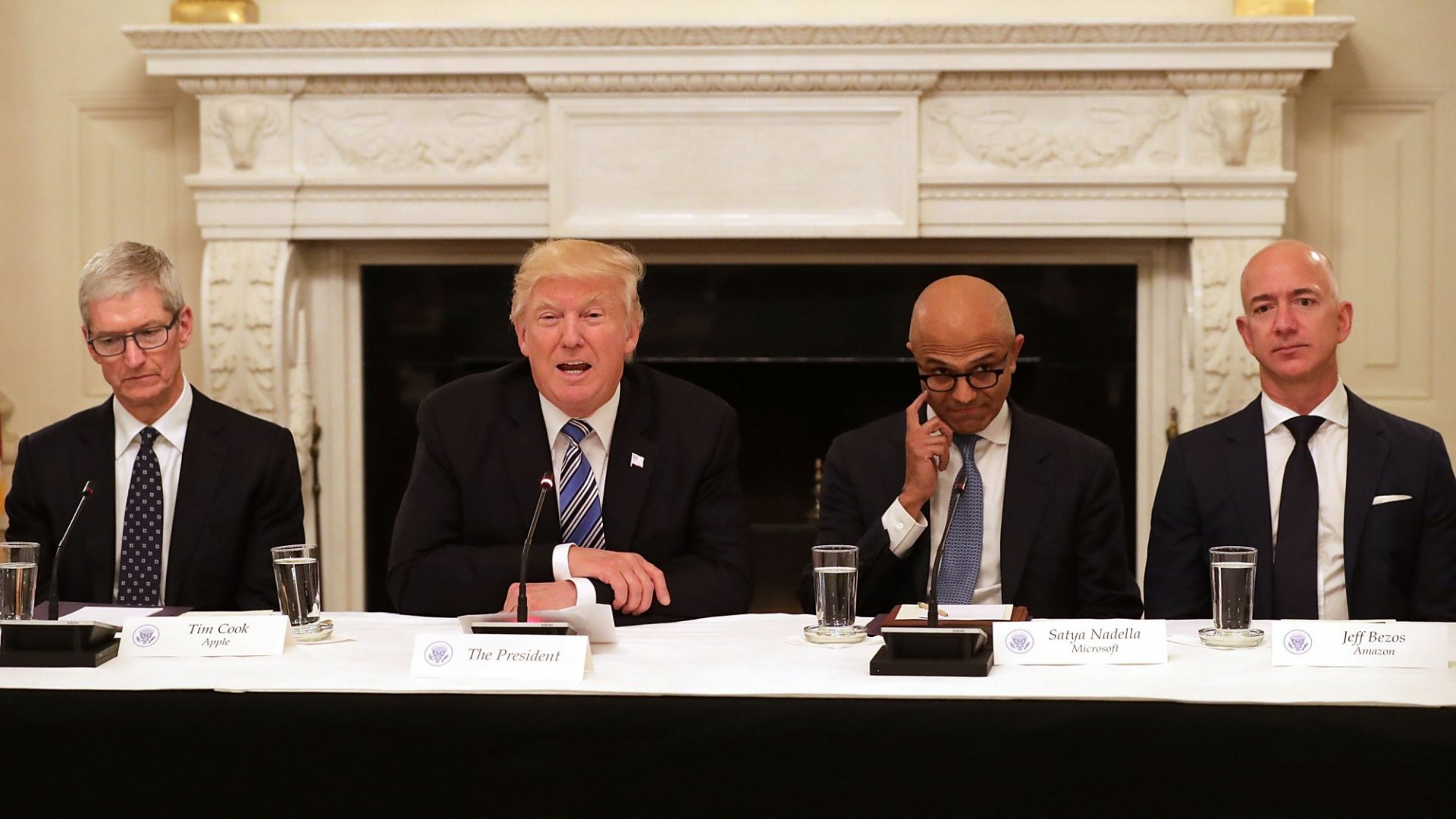 Apple's Tim Cook, President Donald Trump, Microsoft's Satya Nadella, and Amazon's Jeff Bezos.