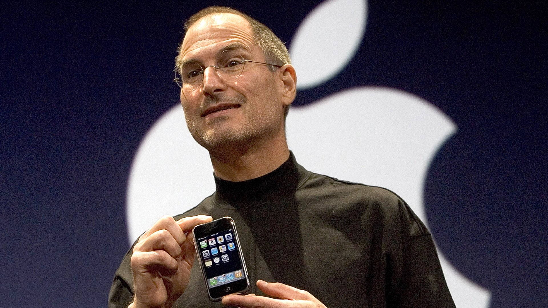 Apple founder Steve Jobs holds up the new iPhone that was introduced at Macworld on January 9, 2007 in San Francisco, California.