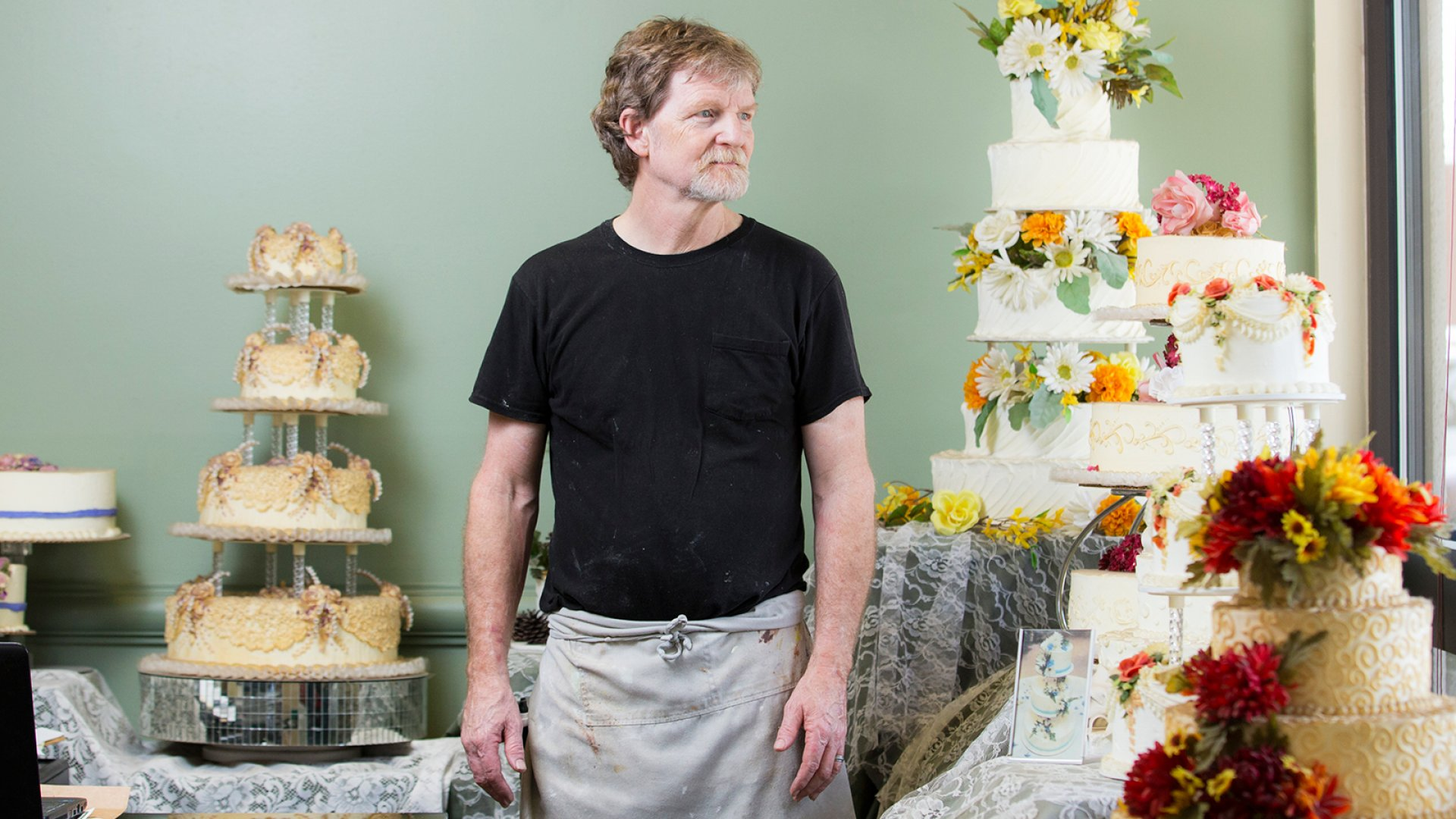 Jack Phillips stands for a portrait near a display of wedding cakes in his Masterpiece Cakeshop in Lakewood, CO on Thursday, September 1, 2016.