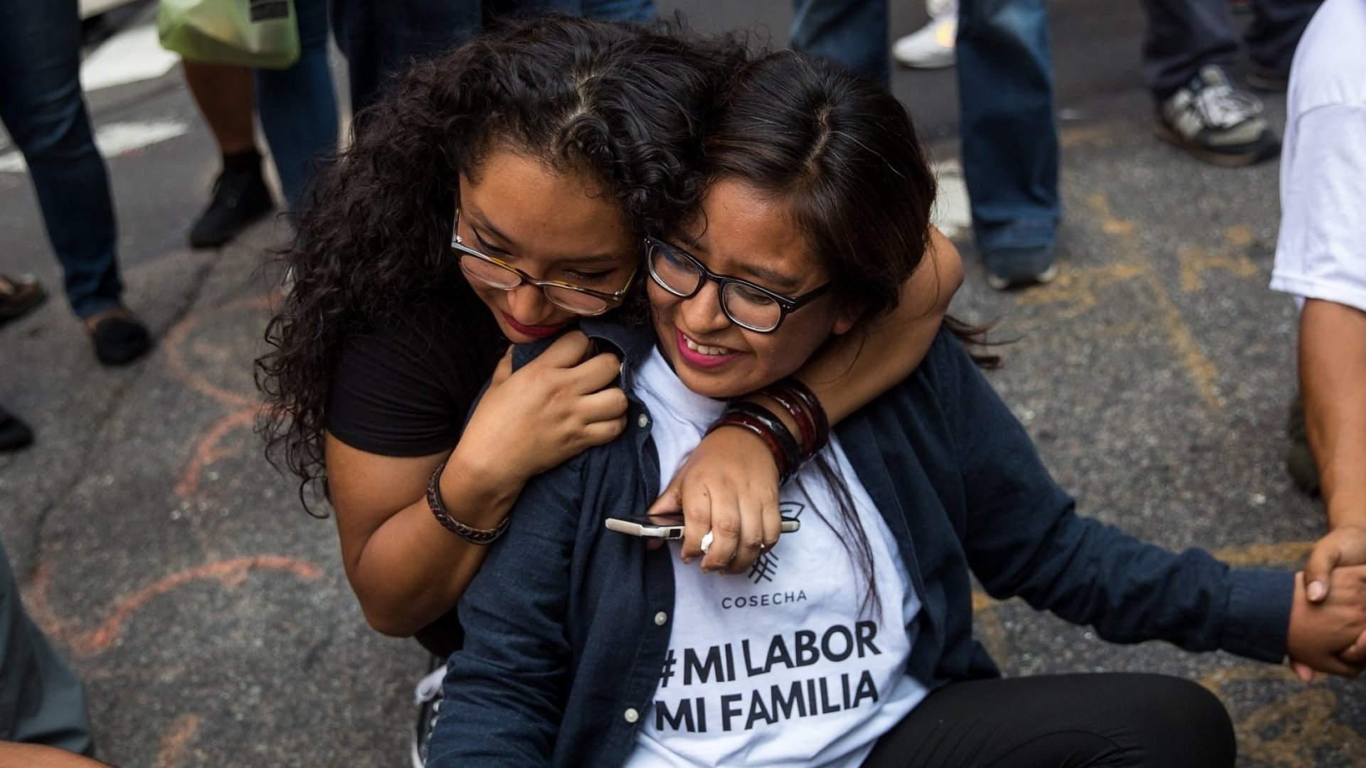 Immigration activists protesting the Trump administration's decision on the Deferred Action for Childhood Arrivals program sit in the street and block traffic on 5th Avenue near Trump Tower, September 5, 2017.
