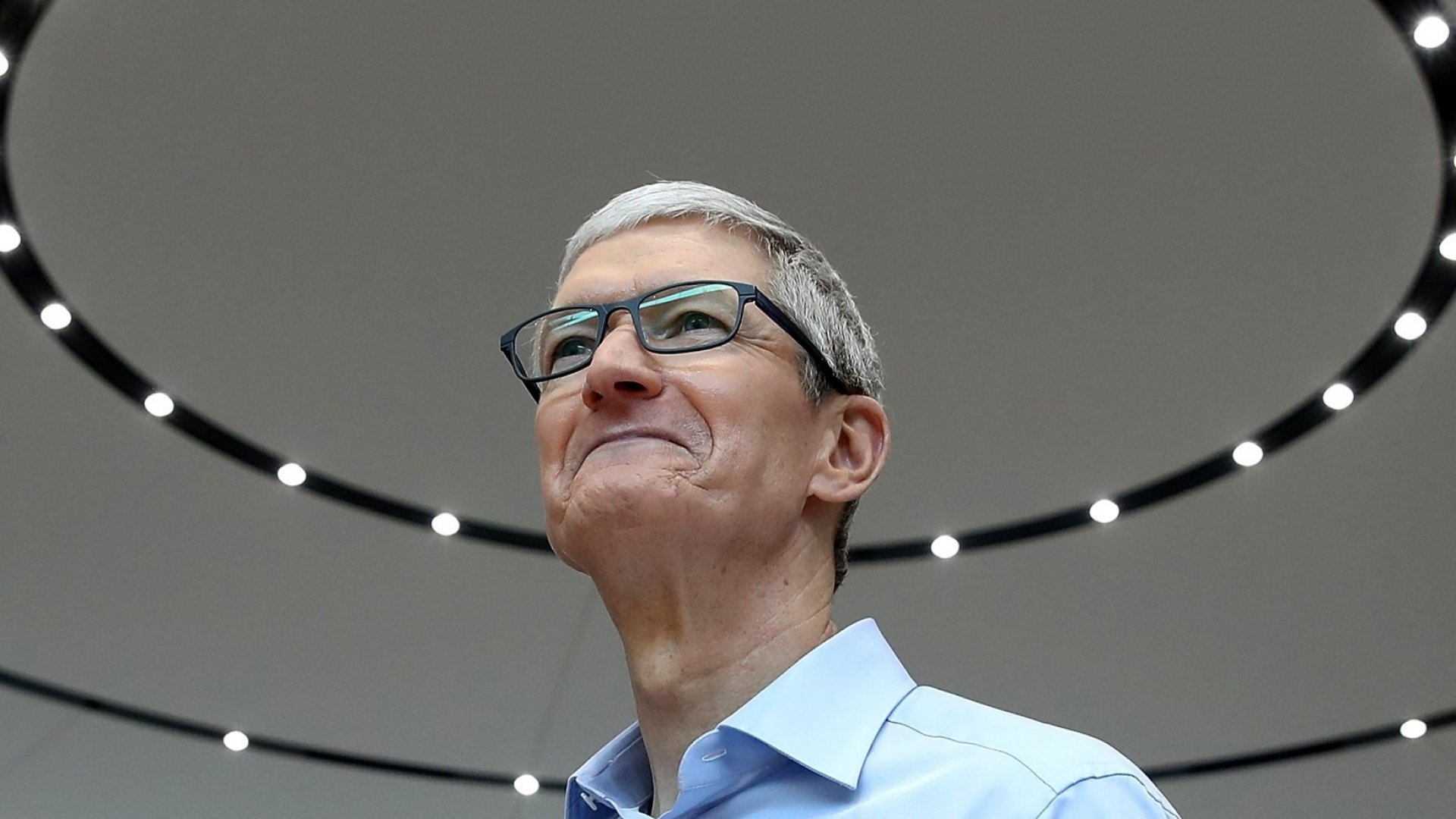 Apple CEO Tim Cook looks on during an Apple special event