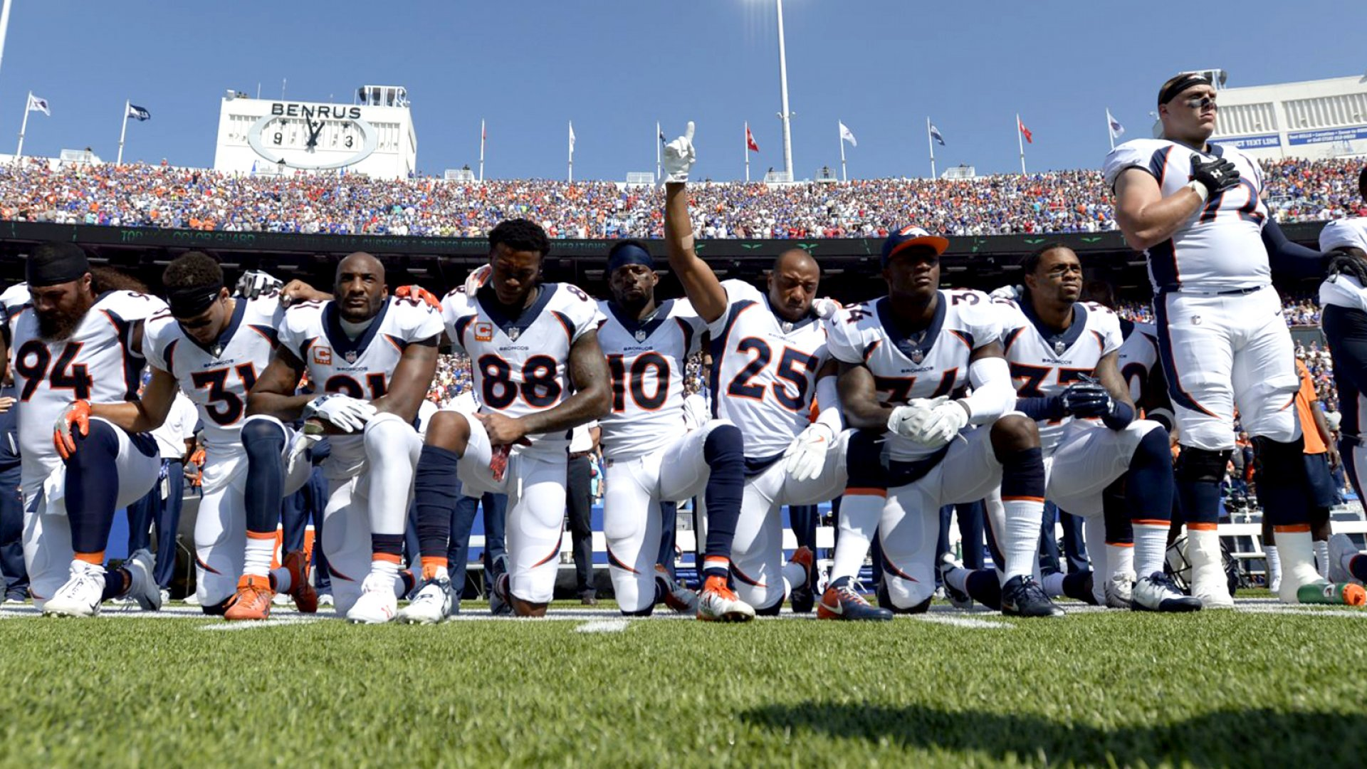 Denver Broncos team take a knee during the national anthem before a game against the Buffalo Bills on September 24, 2017