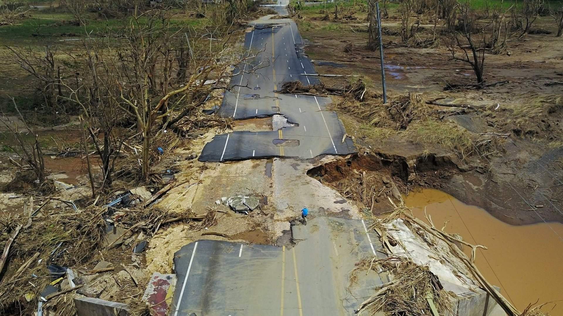 a damaged road in Toa Alta, west of San Juan, Puerto Rico, on September 24, 2017 following the passage of Hurricane Maria.