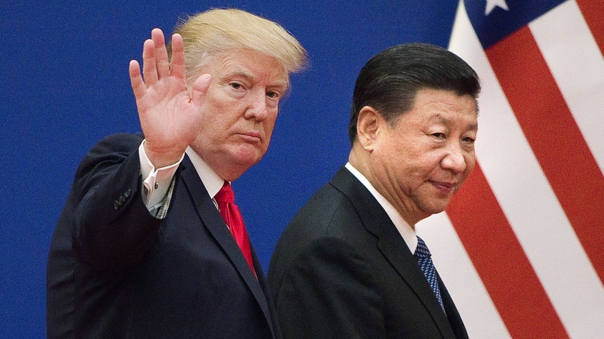 U.S. president Donald Trump (left) and Chinese president Xi Jinping leave a business leaders event at the Great Hall of the People in Beijing on November 9, 2017.