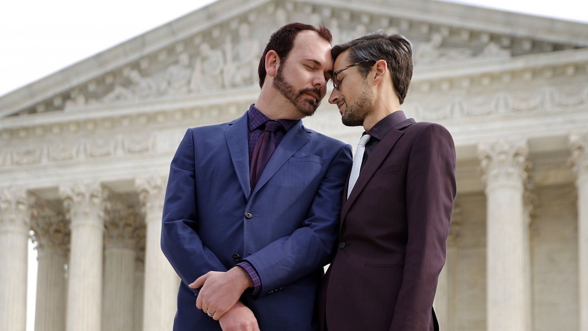 David Mullins (L) and Charlie Craig wait to speak to journalists after the U.S. Supreme Court heard the case <em>Masterpiece Cakeshop</em> v. <em>Colorado Civil Rights Commission</em> on December 5, 2017, in Washington, D.C. Craig and Mullins filed a complaint with the commission in 2012 after conservative Christian baker Jack Phillips refused to sell them a wedding cake for their same-sex ceremony.