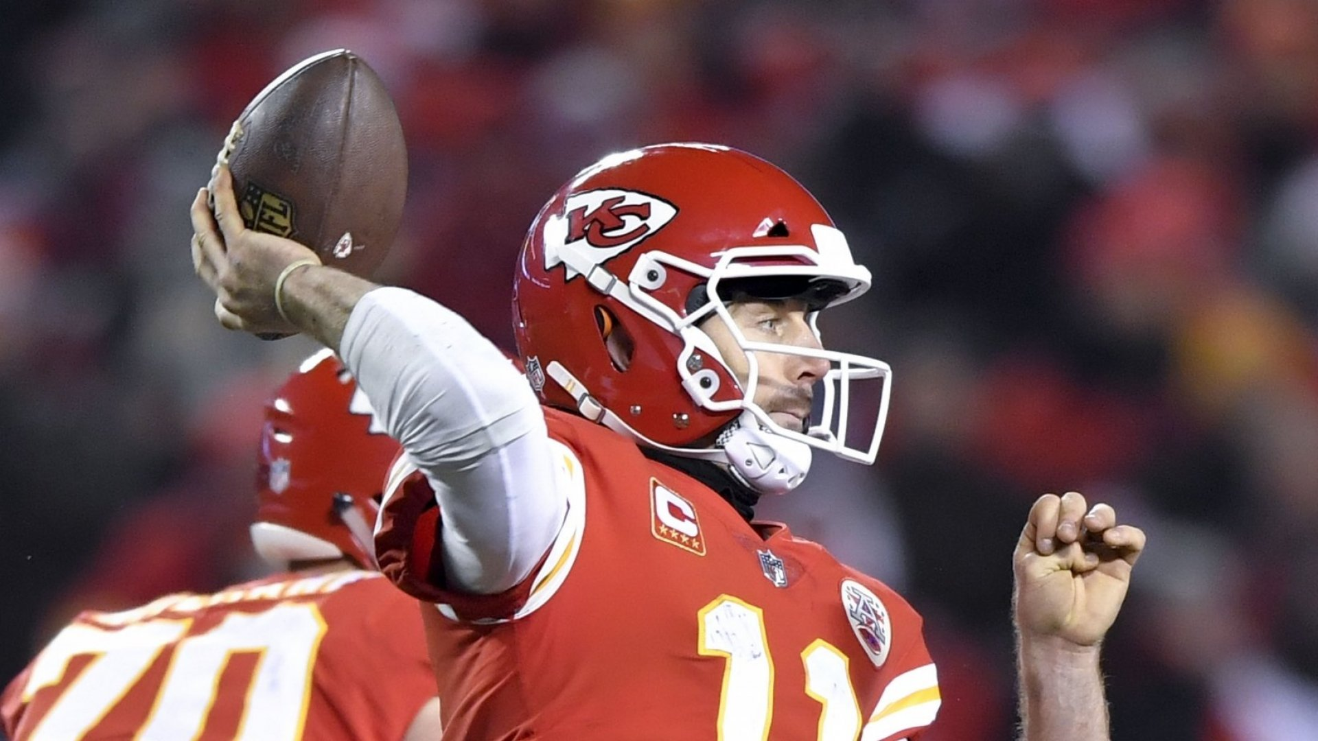 Kansas City Chiefs quarterback Alex Smith throws a pass during a playoff game while wearing Vicis's Zero1 helmet.