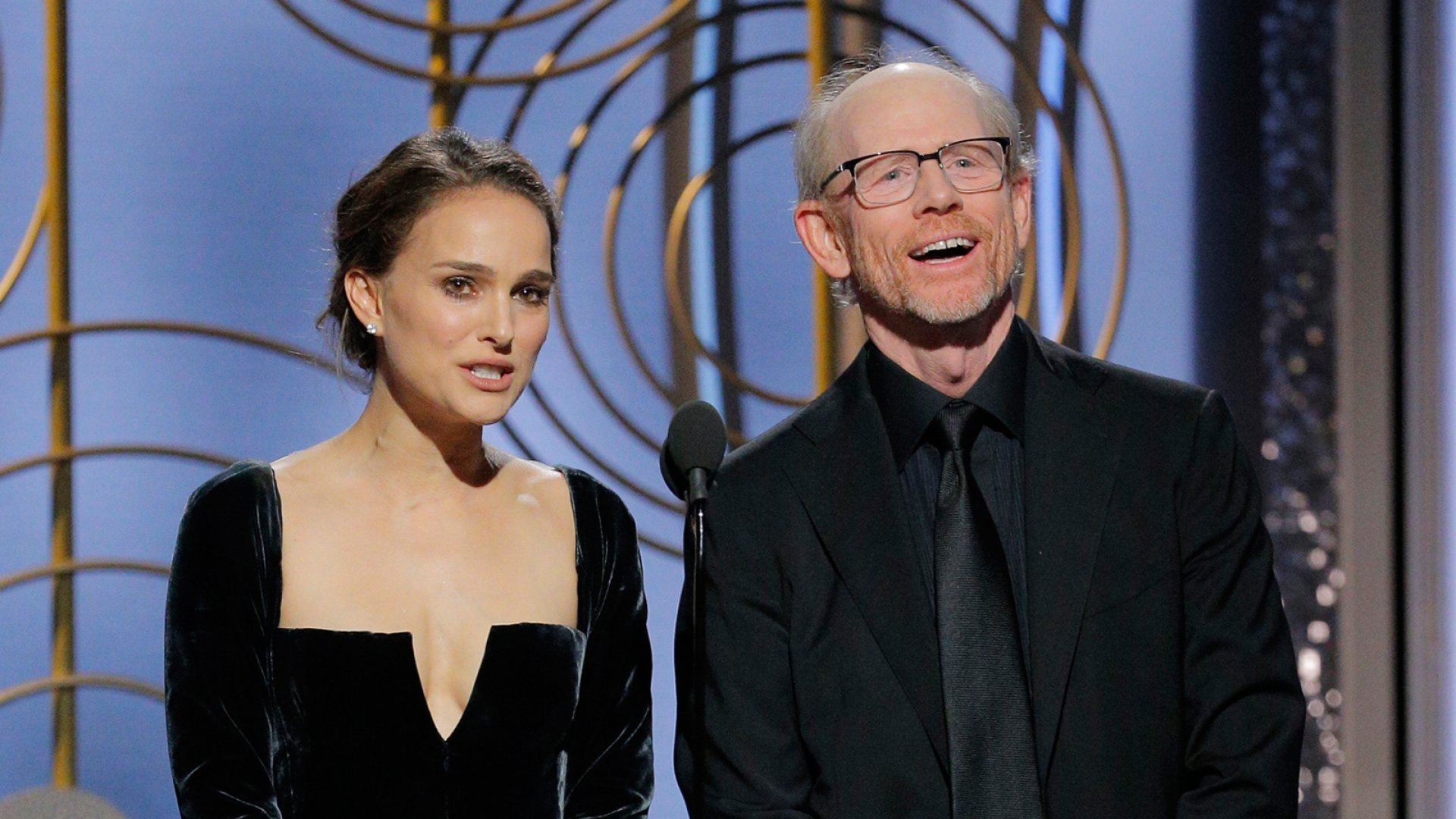 Presenters Natalie Portman and Ron Howard speak onstage during the 75th Annual Golden Globe Awards.