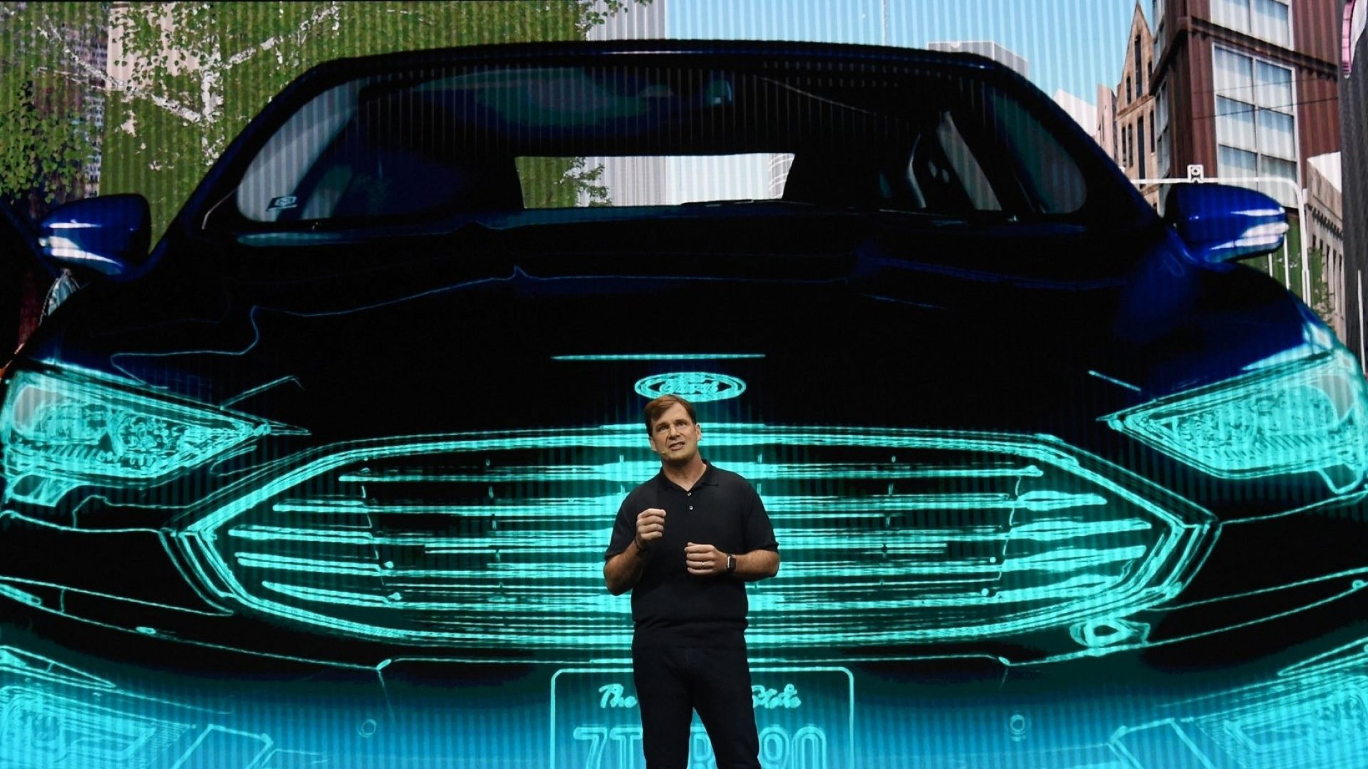 Ford Motor Co.'s Jim Farley speaks during a keynote address Tuesday at CES 2018 in Las Vegas.