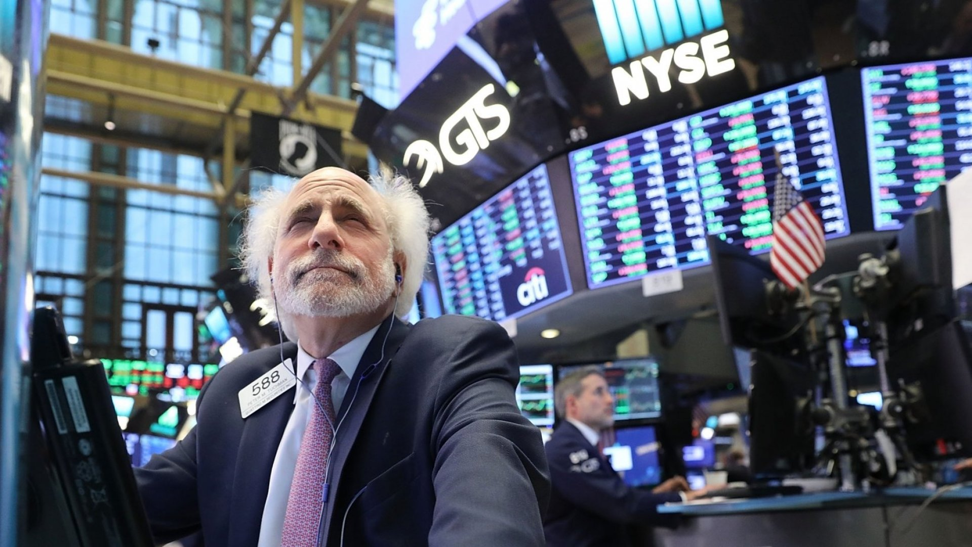 Traders work on the floor of the New York Stock Exchange (NYSE) on February 6, 2018 in New York City. Following Monday's over 1000 point drop, the Dow Jones Industrial Average closed up over 500 points.