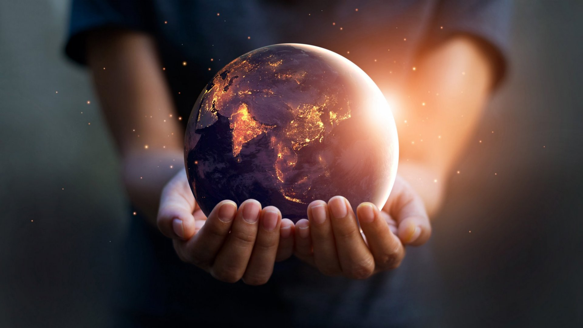 Hands holding a globe.