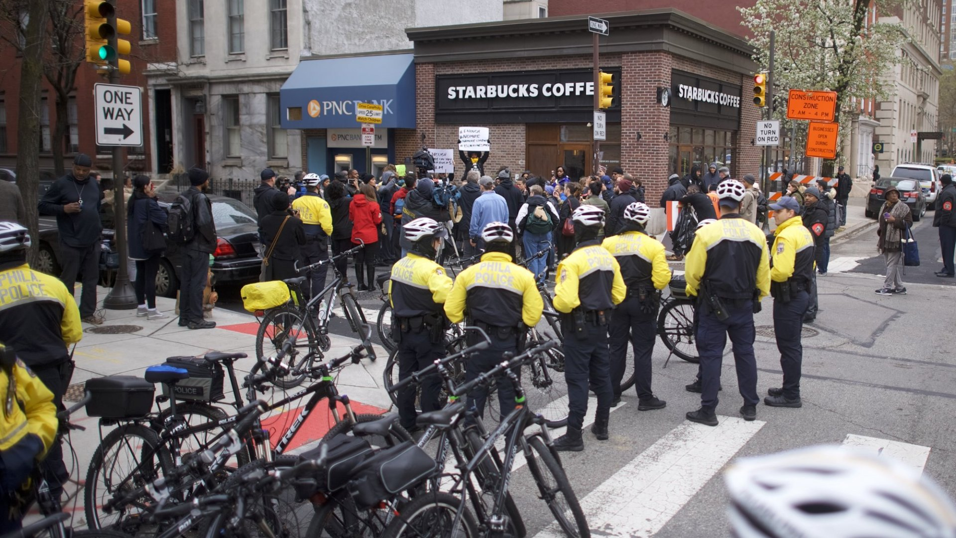 Police monitor activity as protestors demonstrate outside a Center City Starbucks on April 15, 2018, in Philadelphia. Police arrested two black men who were waiting inside the Center City Starbucks, which prompted an apology from the company's CEO.
