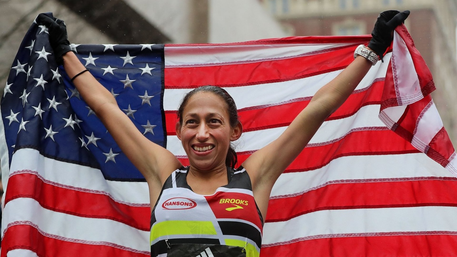 2018 Boston Marathon women's winner Desiree Linden celebrates after she crosses the finish line on April 16, 2018.