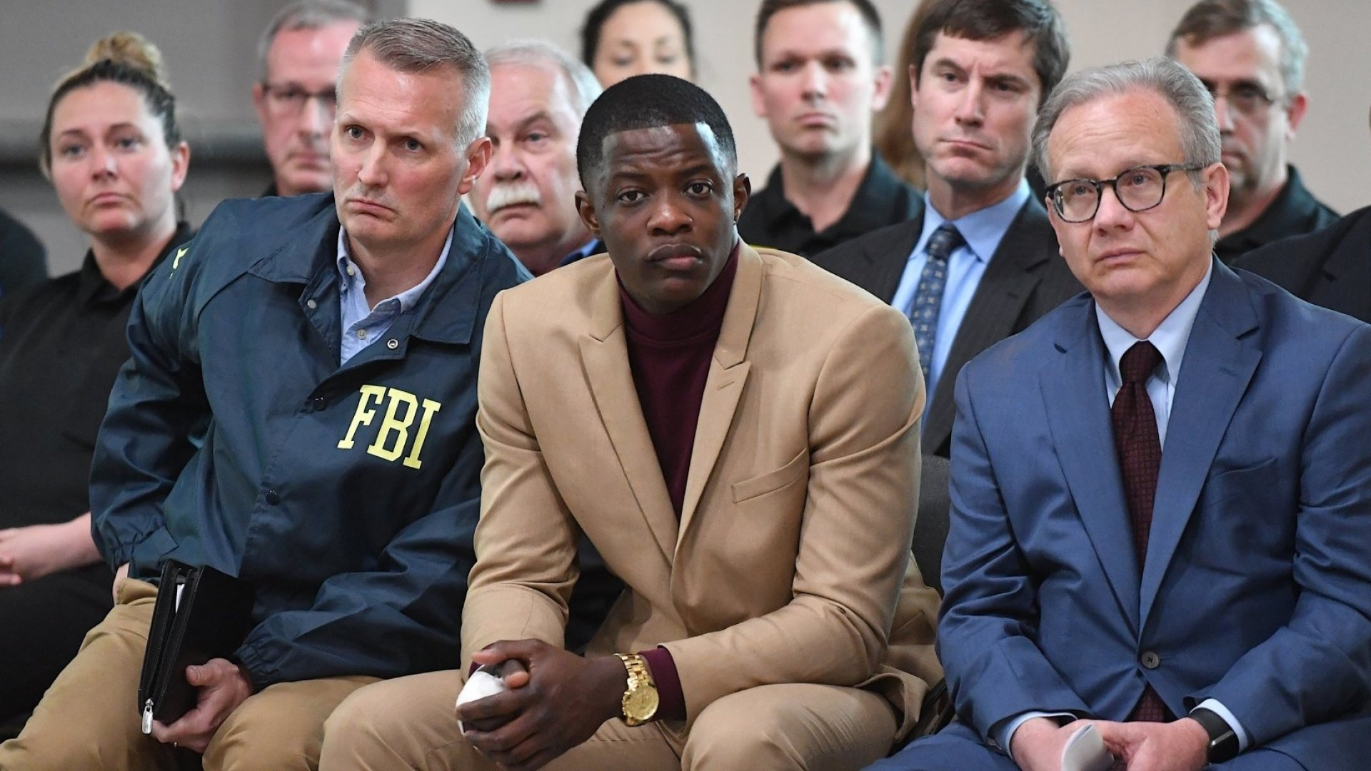 Waffle House patron James Shaw Jr. (center), who stopped the shooting at a Waffle House where a gunman opened fire killing four and injuring two, attends a press conference with FBI special agent in charge Matthew Espenshade (left) and Metro Nashville mayor David Briley (right) on April 22, 2018 in Nashville, Tennessee.