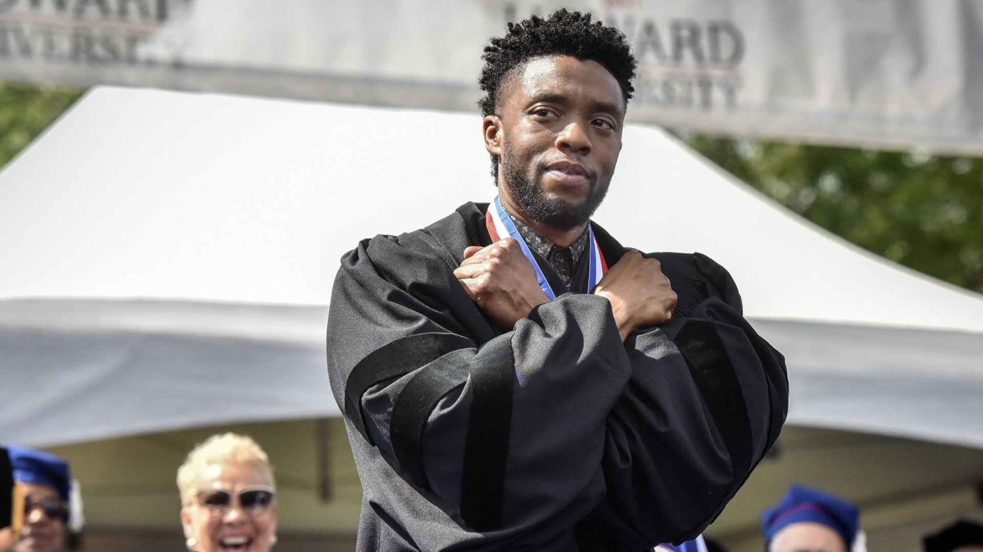 Actor Chadwick Boseman gives a Wakanda salute to the crowd as Howard University holds its commencement ceremonies on May 12, 2018, in Washington, D.C.
