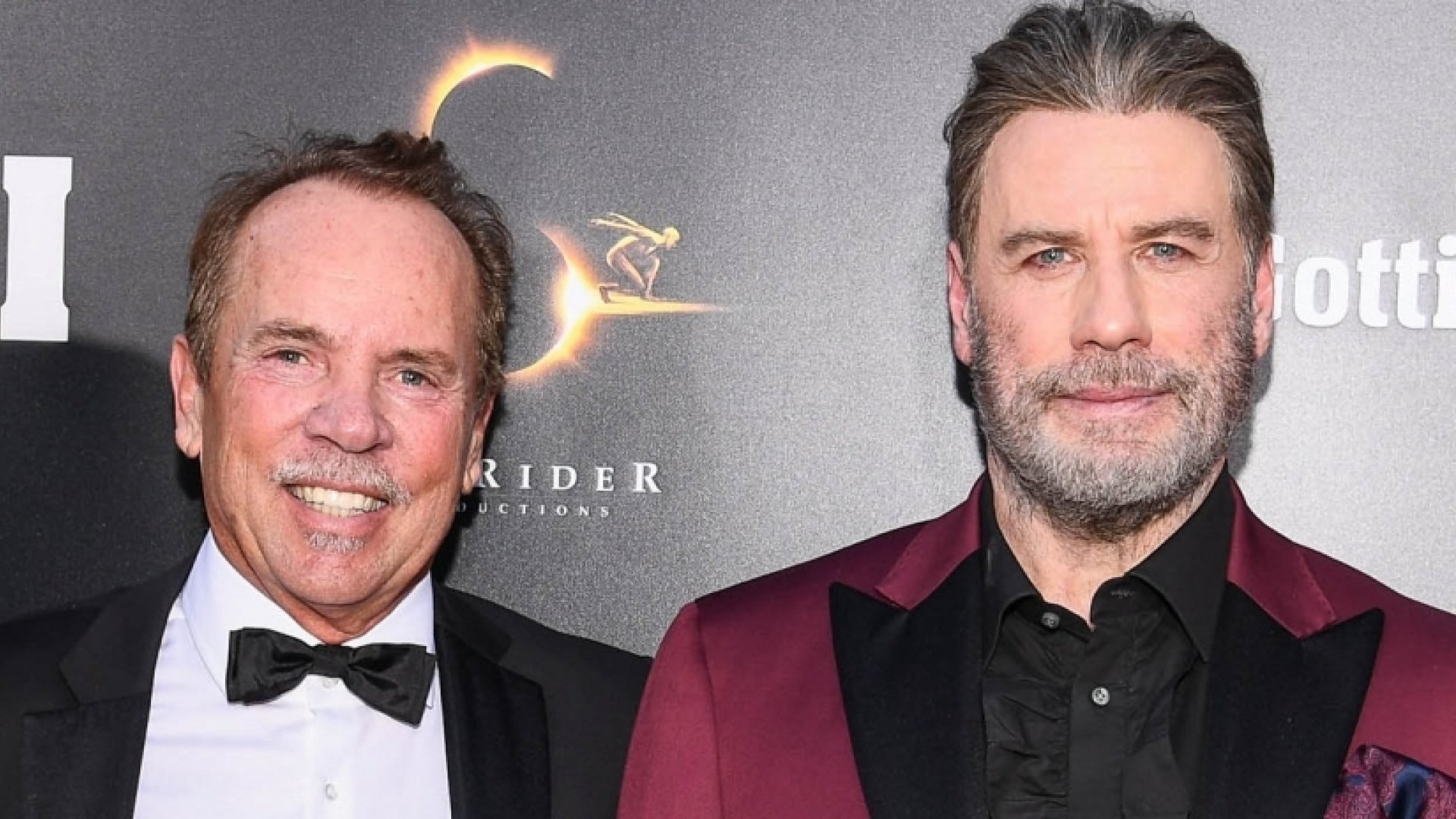 Mitch Lowe, CEO of MoviePass,  and John Travolta