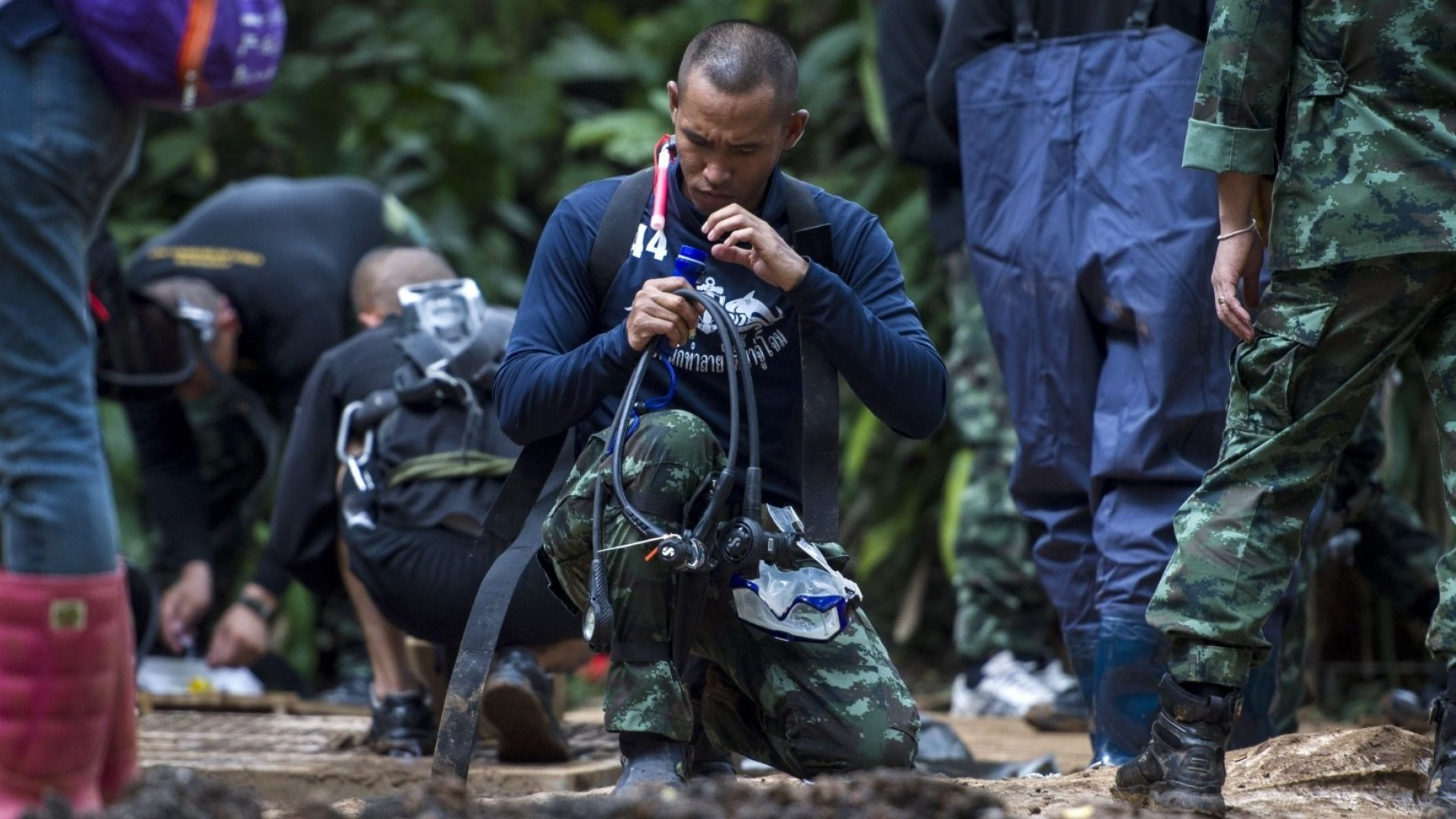 A Thai navy diver prepares during rescue operations for 12 boys and their coach trapped in Tham Luang Cave.