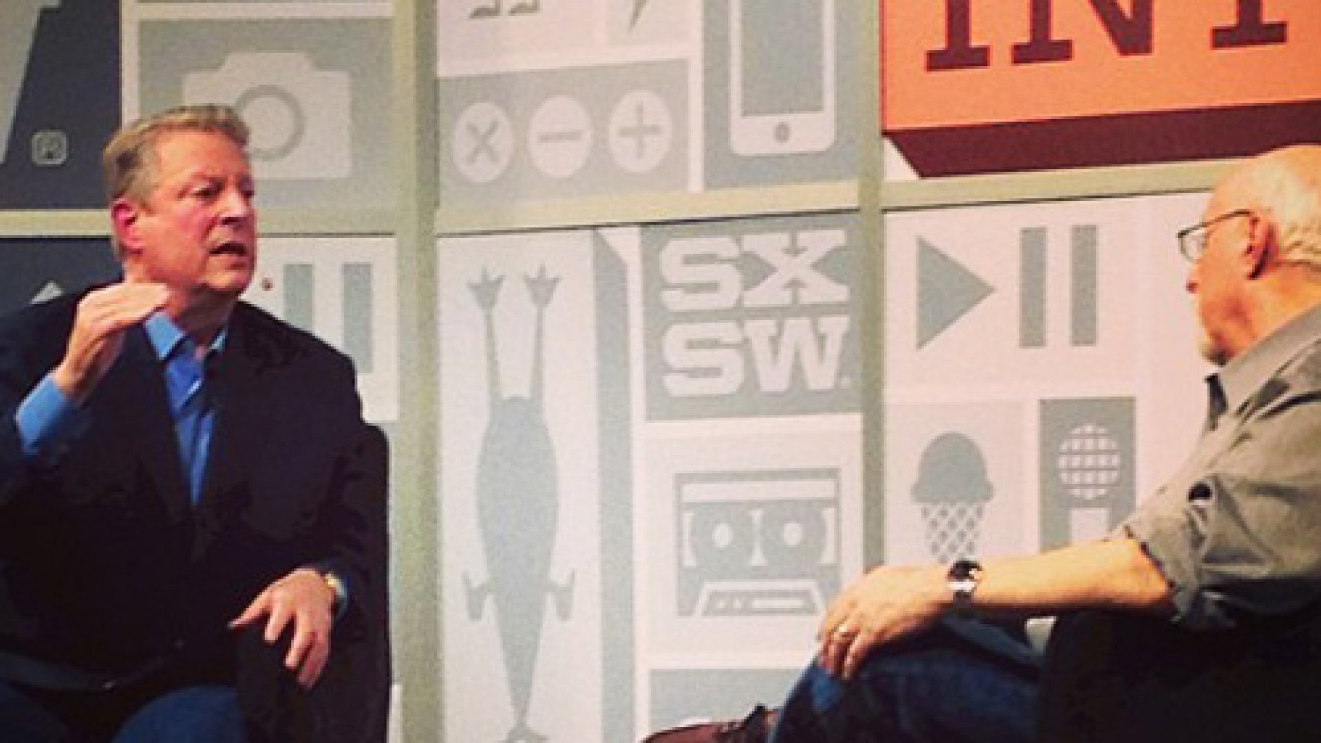 Former U.S. Vice President Al Gore, left, speaks with Wall Street Journal columnist Walt Mossberg during an interview at the South by Southwest Interactive Festival (SXSW) in Austin Texas, U.S., on Saturday, March 9, 2013.