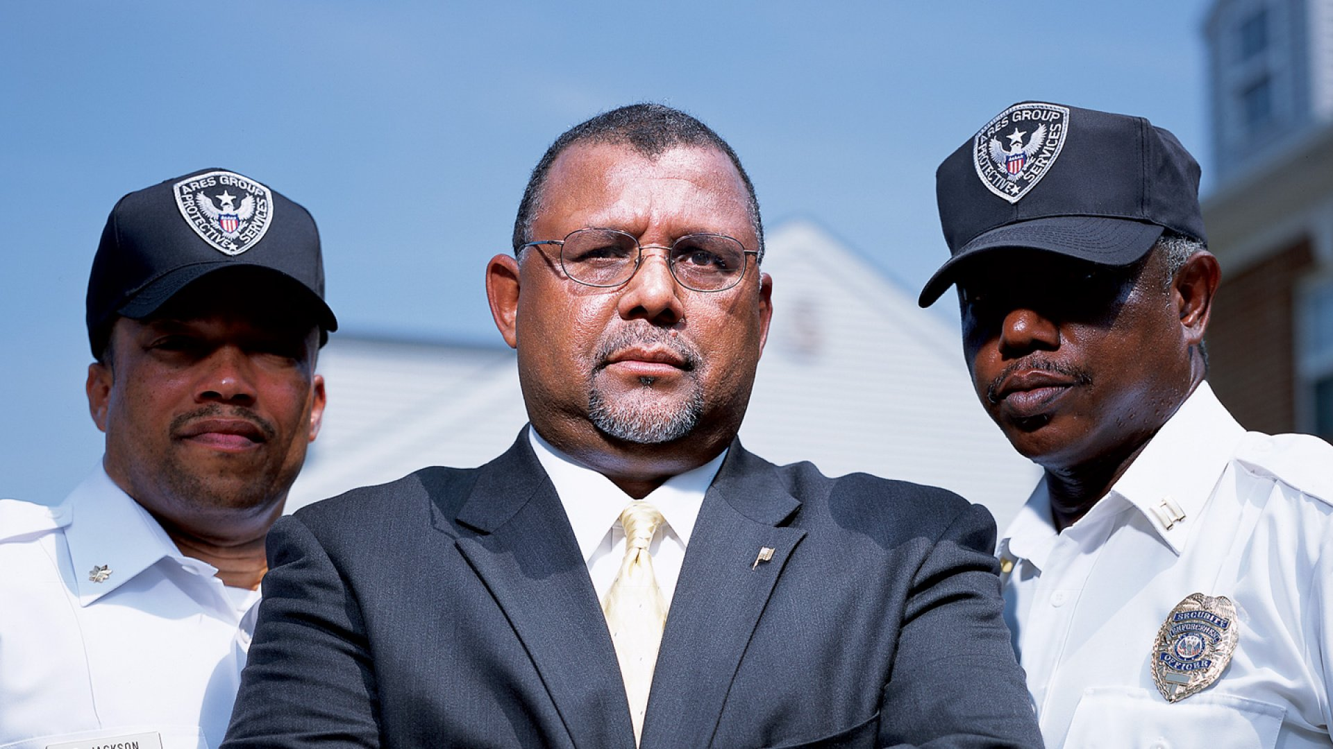 SERIOUS BUSINESS Bruce Moore, center, with field supervisors Eric Jackson, left, and Emanuel Lewis.