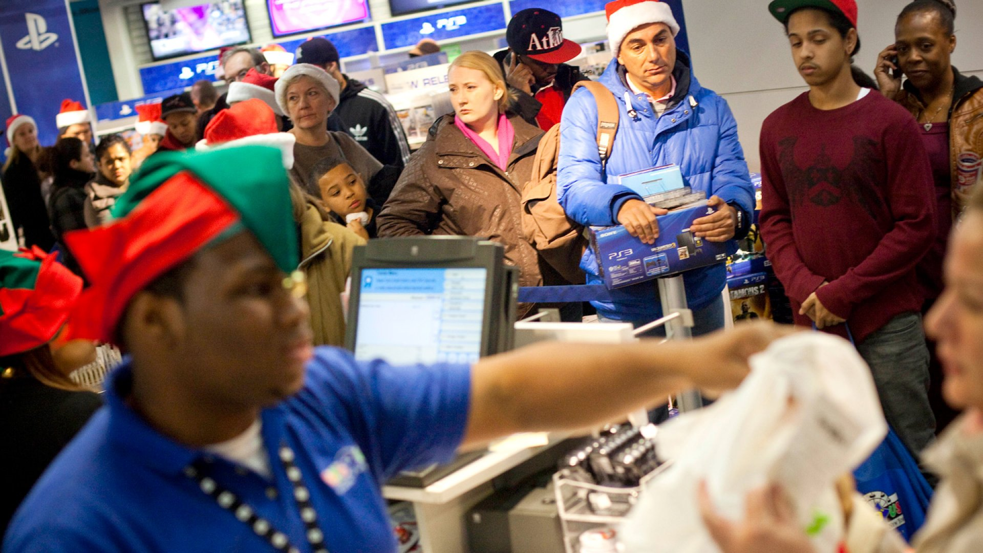 """Black Friday bargain hunters wait in line at Toys """"R"""" Us, which opened at 9 p.m. Thanksgiving Day, November 24, 2011, in New York City."""