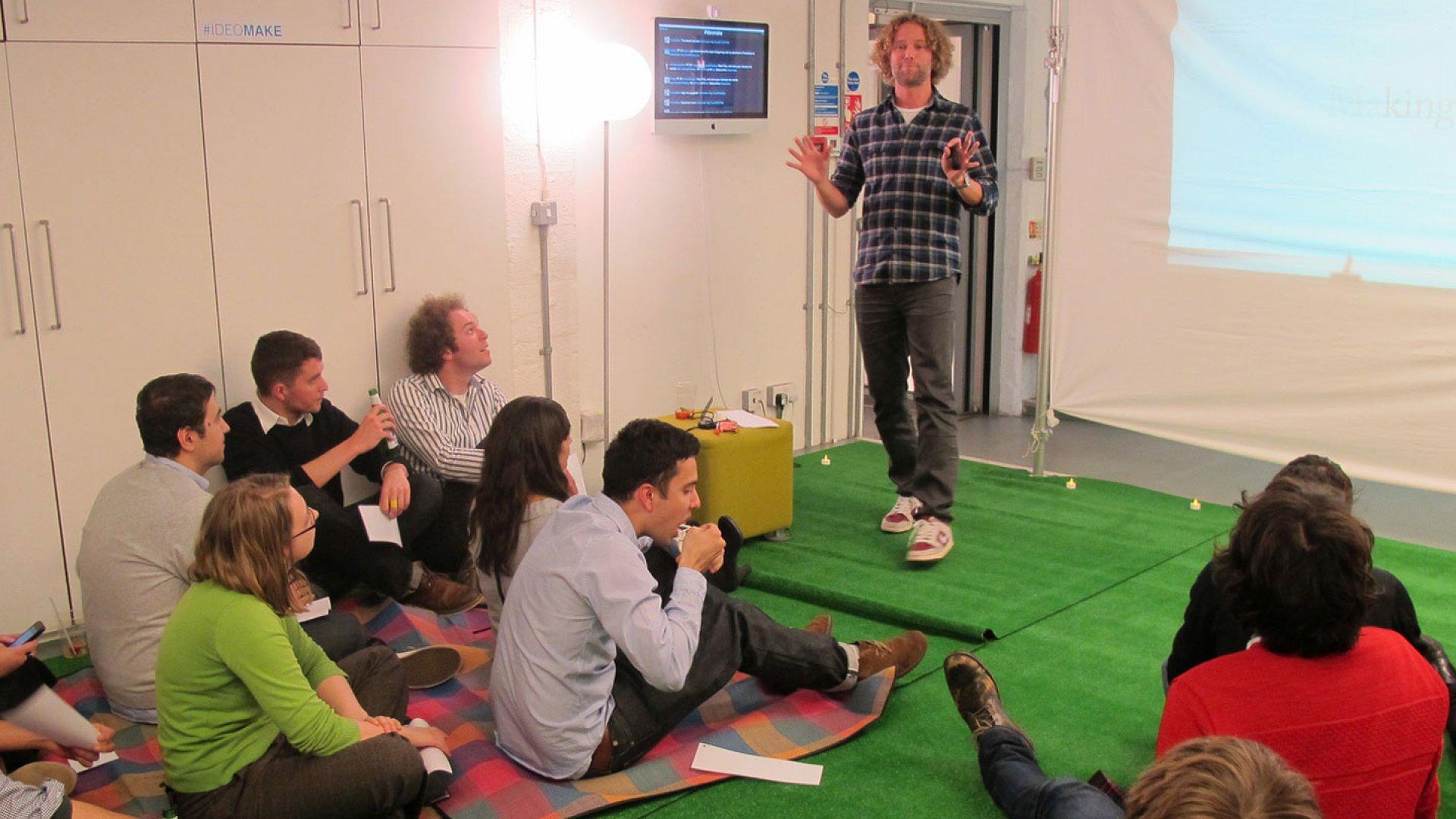 Tom Hulme, Design Director of IDEO London, makes a presentation.
